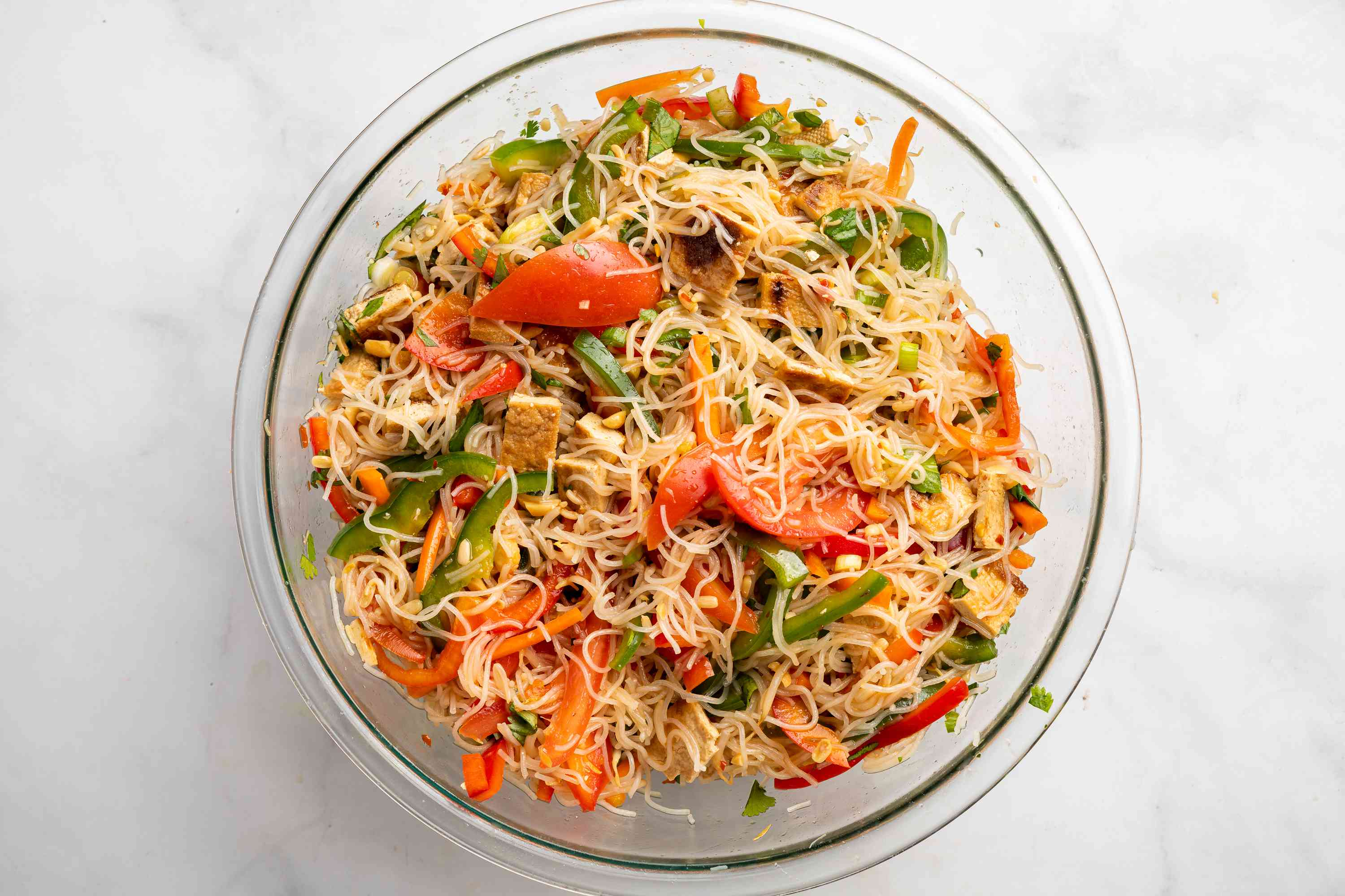Dressing the rice noodle salad