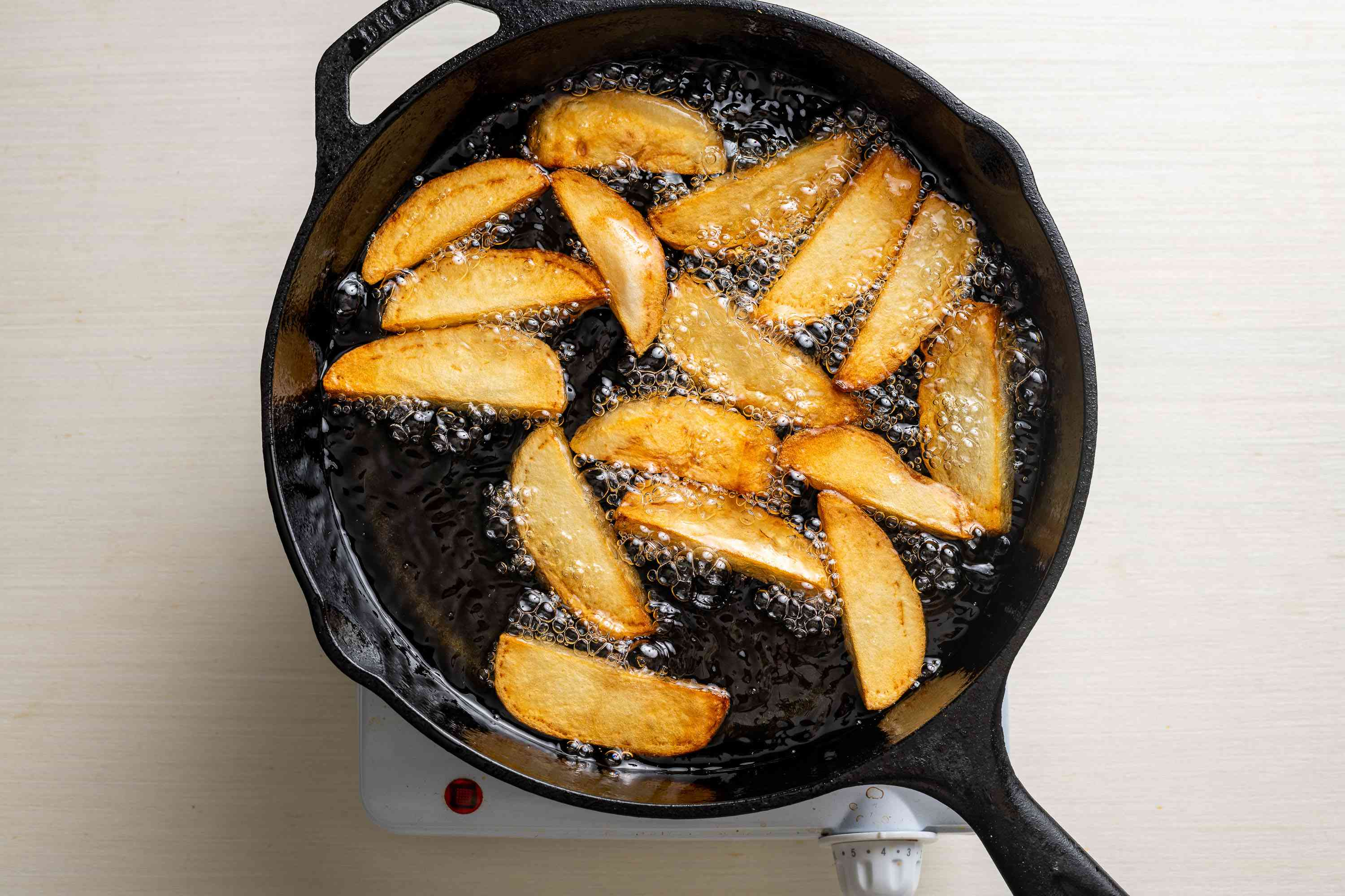 fries in a skillet with oil