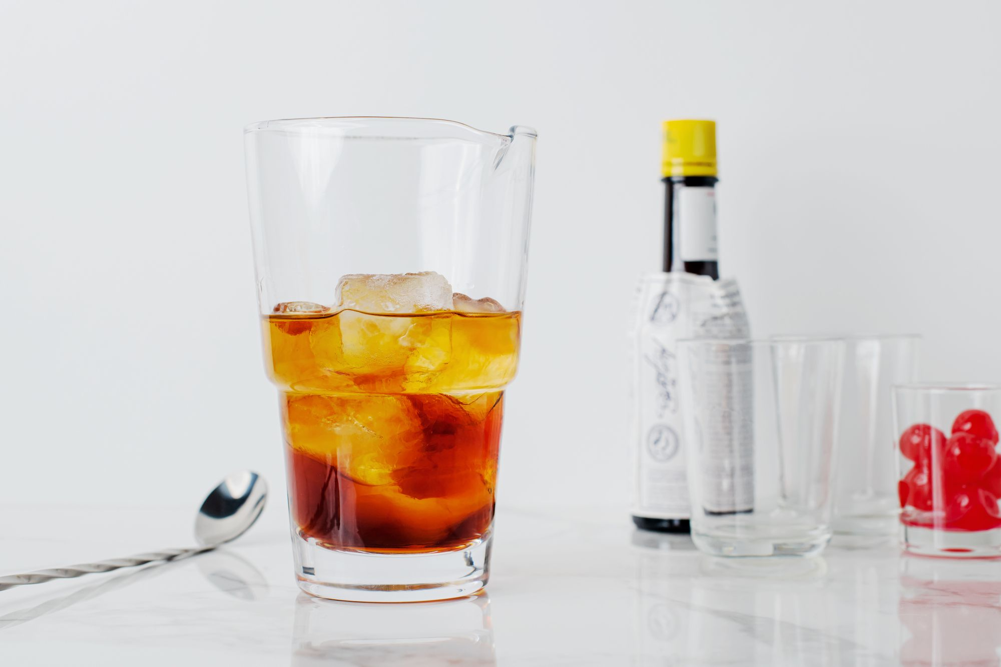 Pour whiskey in glass