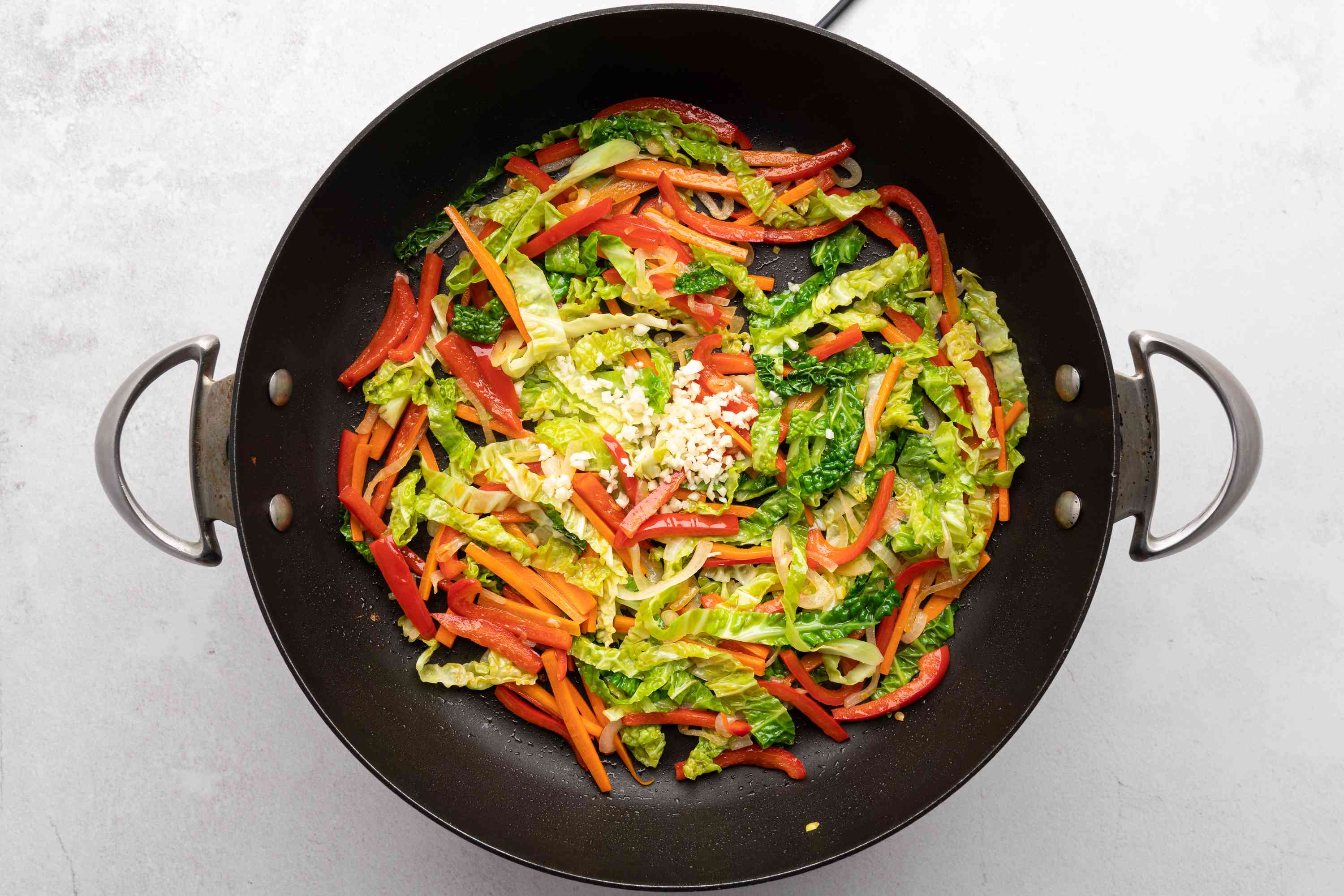 garlic and vegetables in a wok