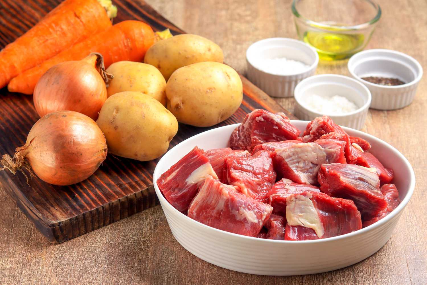 lamb stew ingredients of meat, potatoes, and carrots
