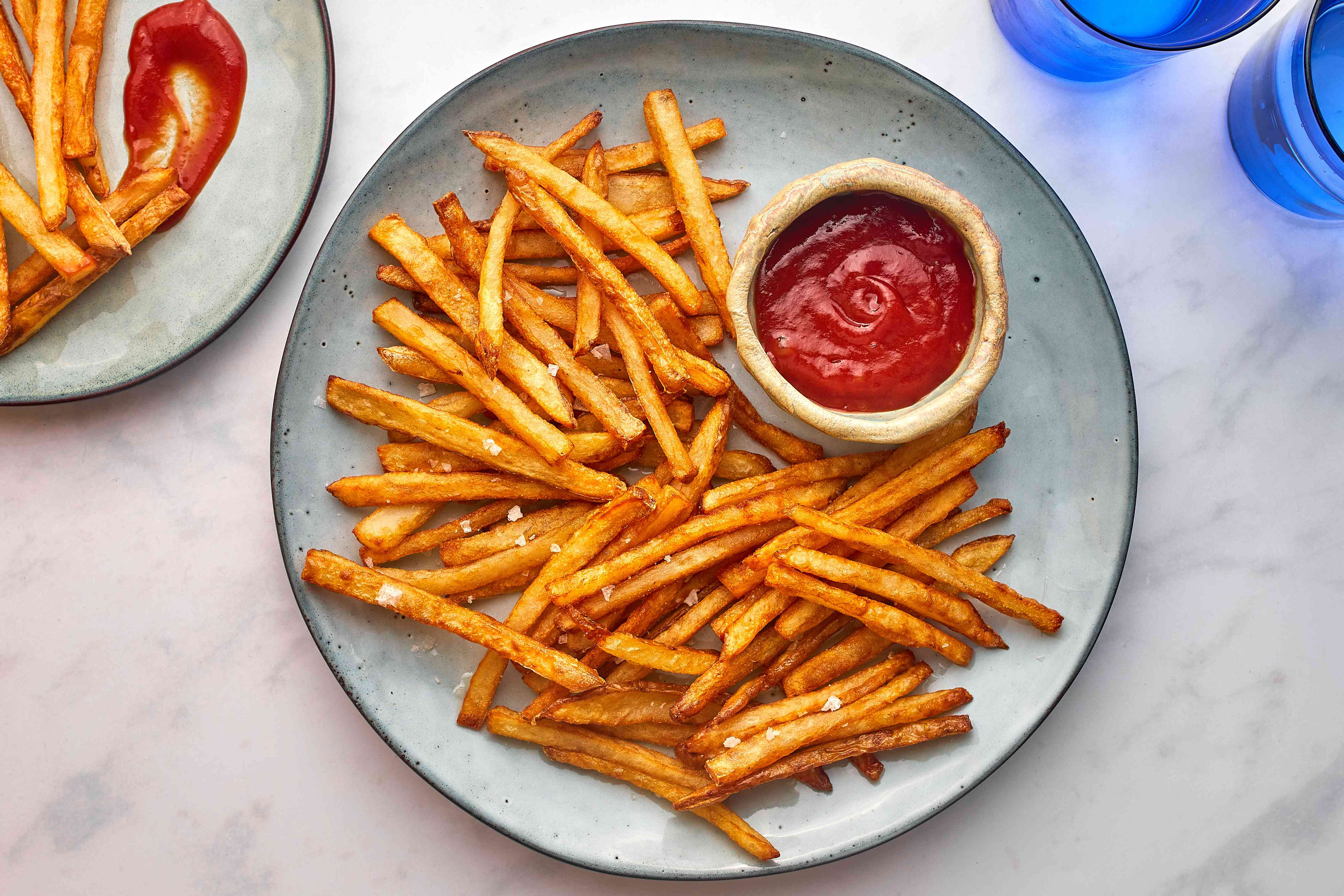 Homemade French Fries on a plate with ketchup