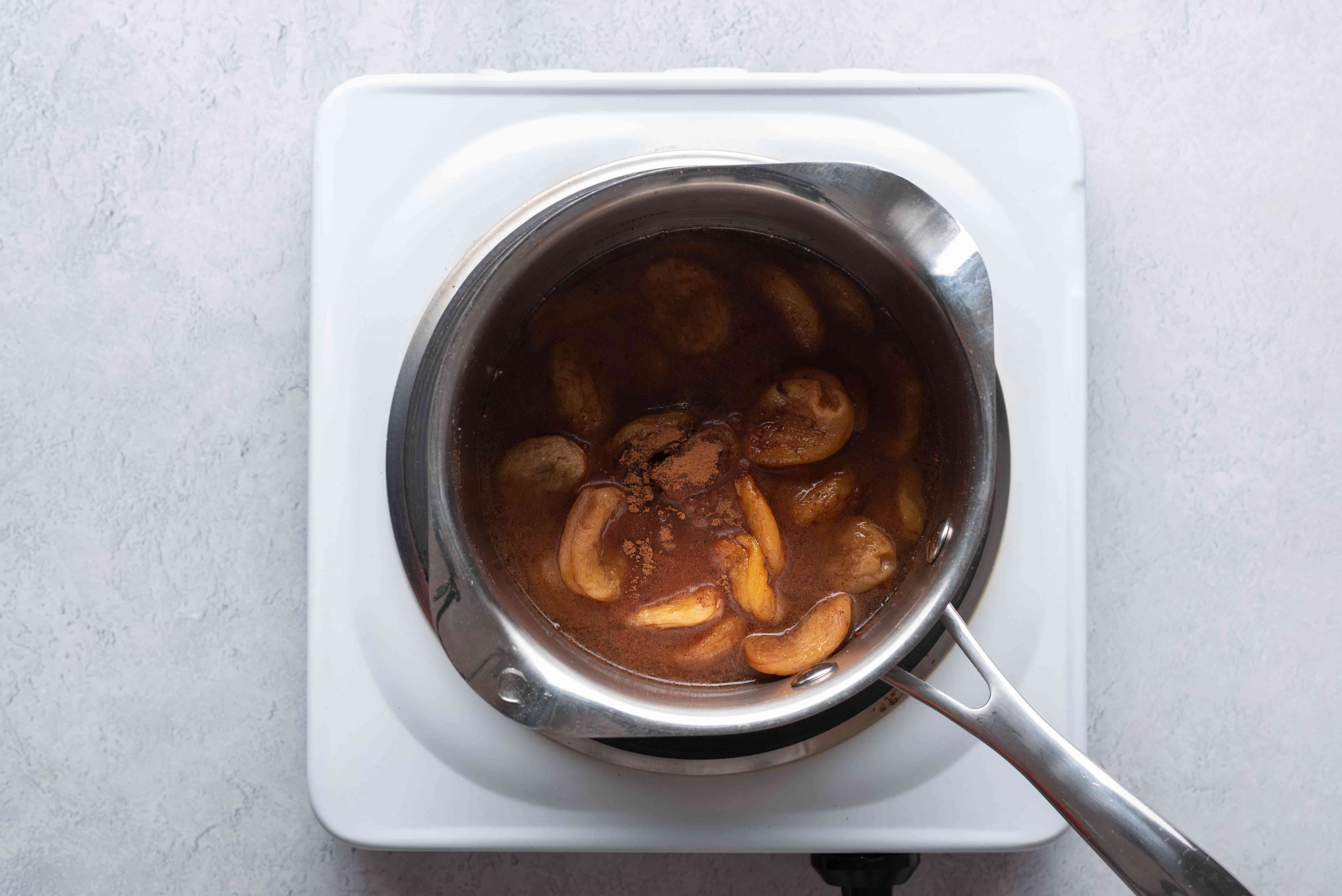apricots with reserved tagine cooking liquid in pot