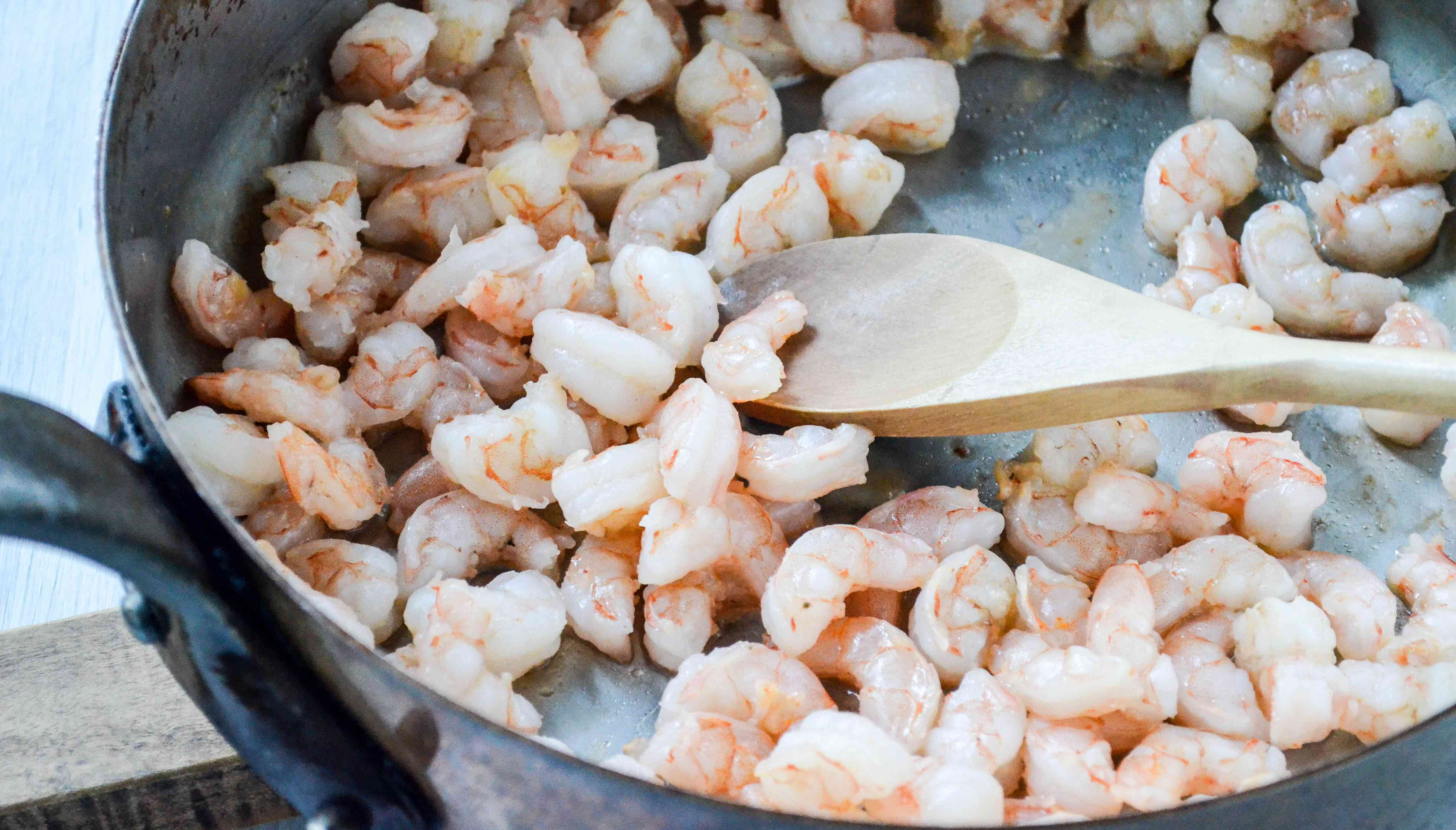 Cook the shrimp for shrimp avocado salad