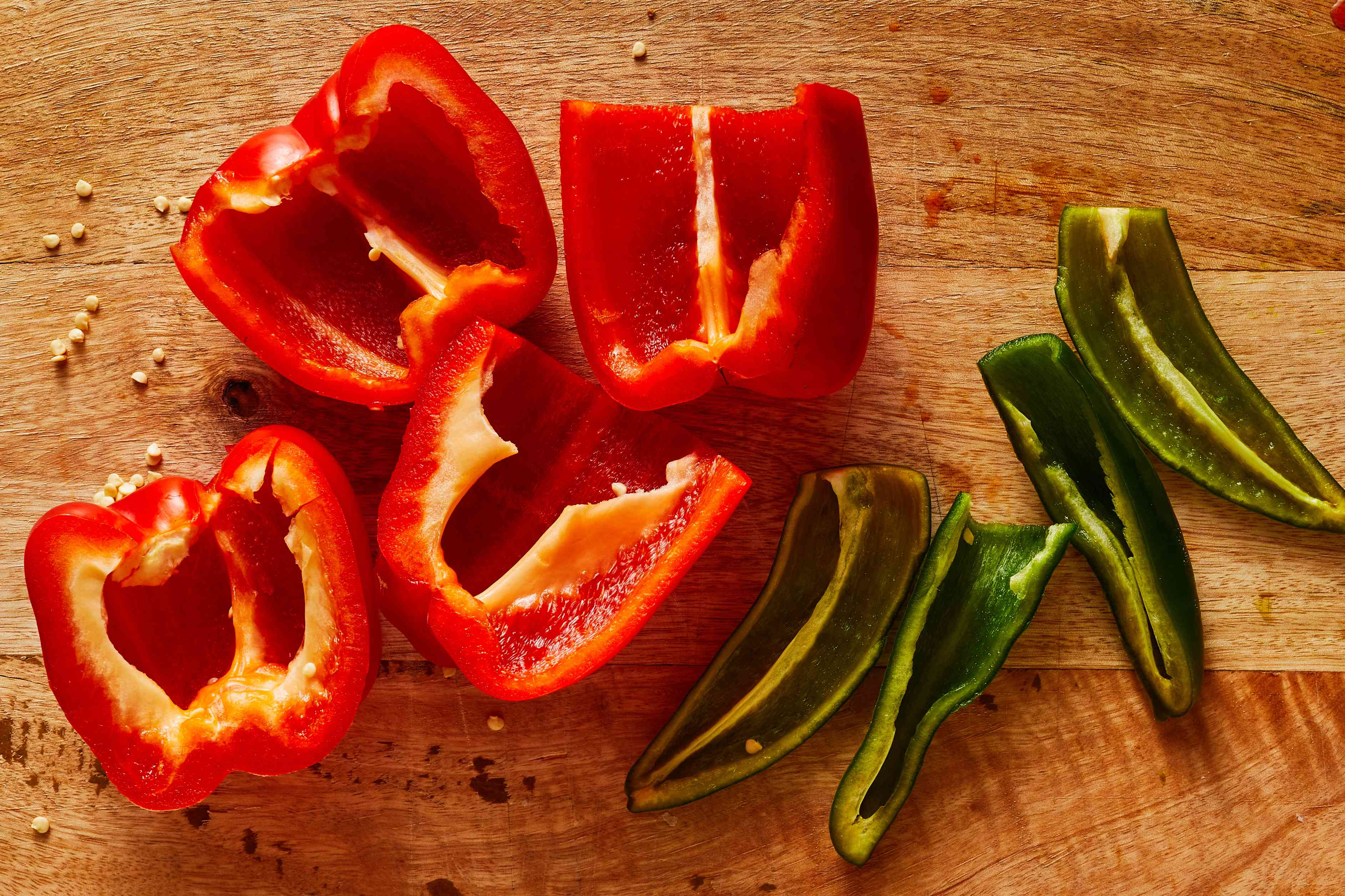 Slice the peppers in half, lengthwise, and discard the seeds and veins