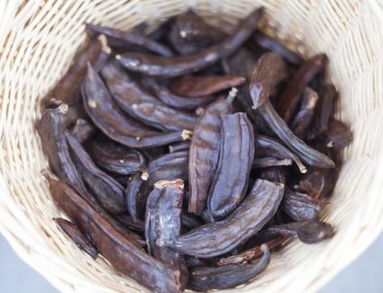 Carob tree beans in a basket