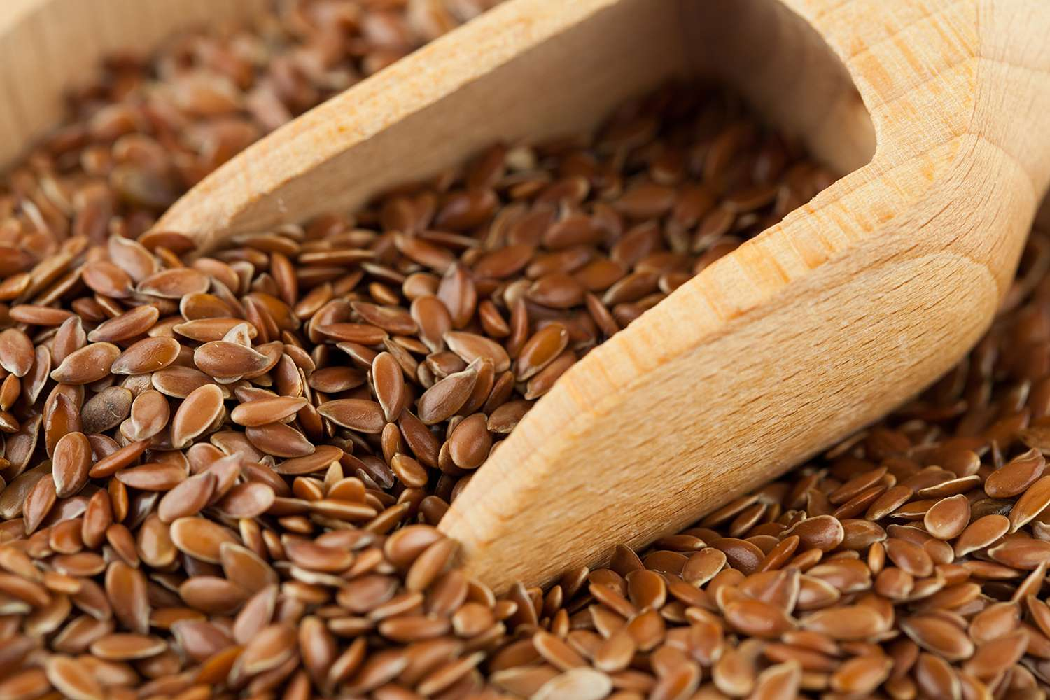 Flax seeds background in the foreground