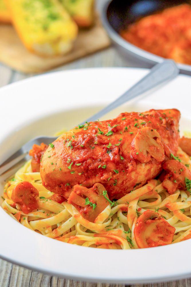Chicken cacciatore over pasta.