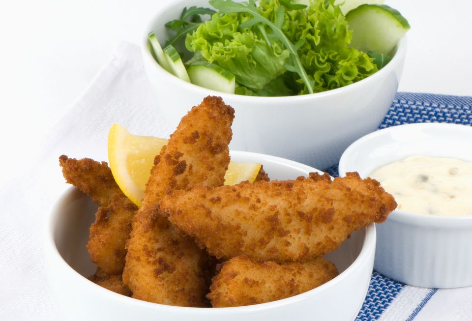 Fried fish with a fresh green salad