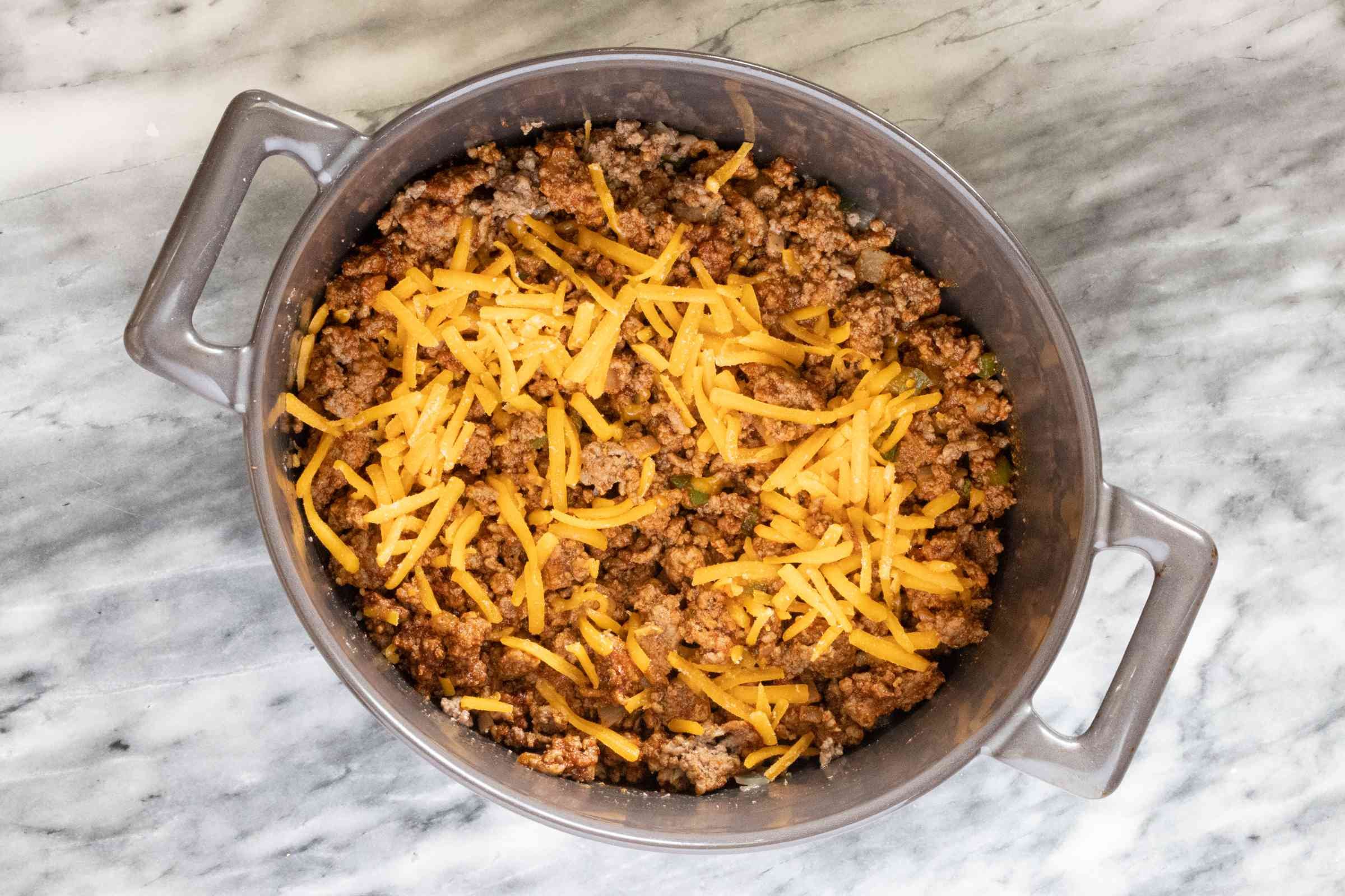 Layering the low carb taco casserole.