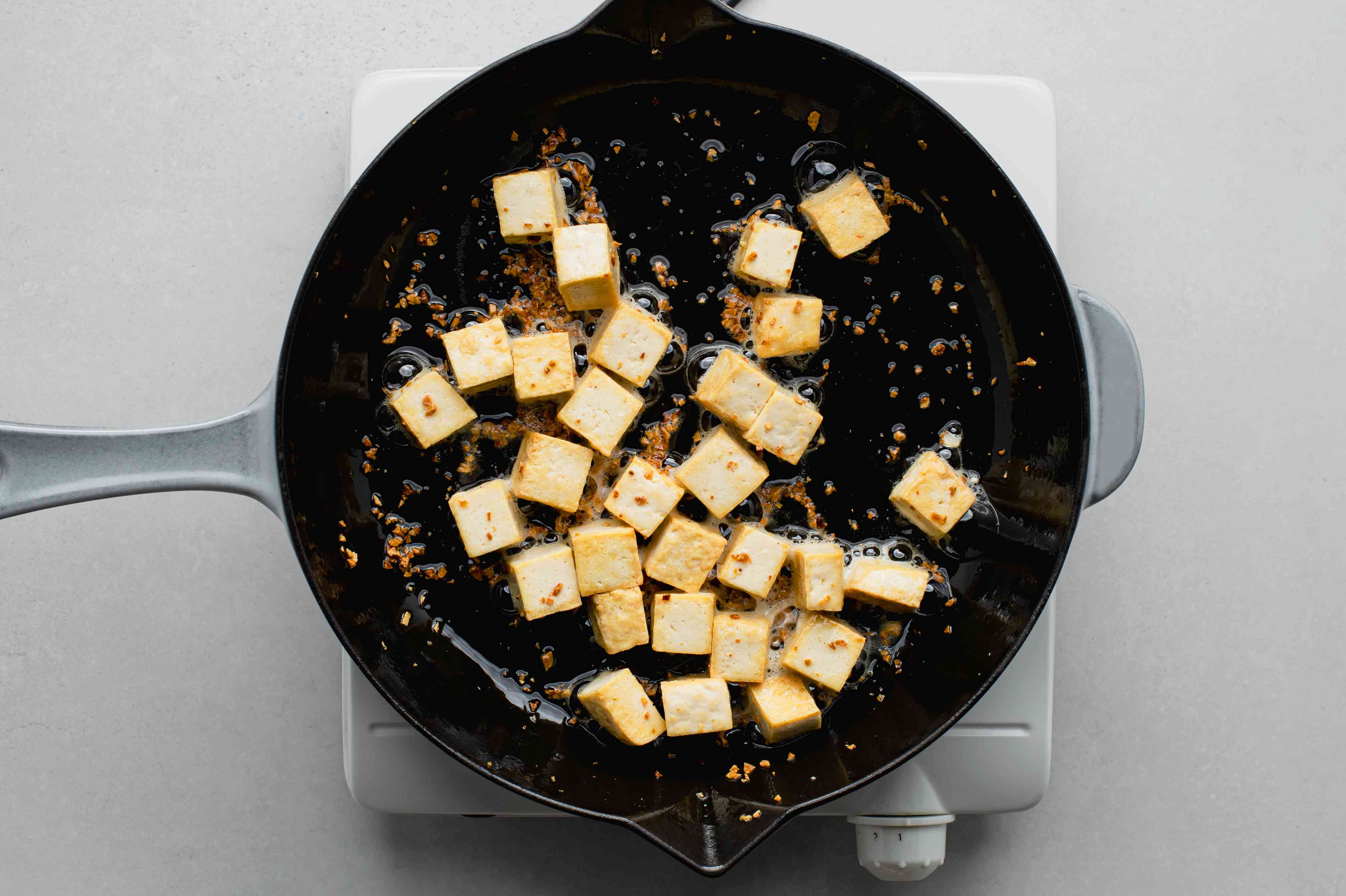 tofu and garlic in a skillet
