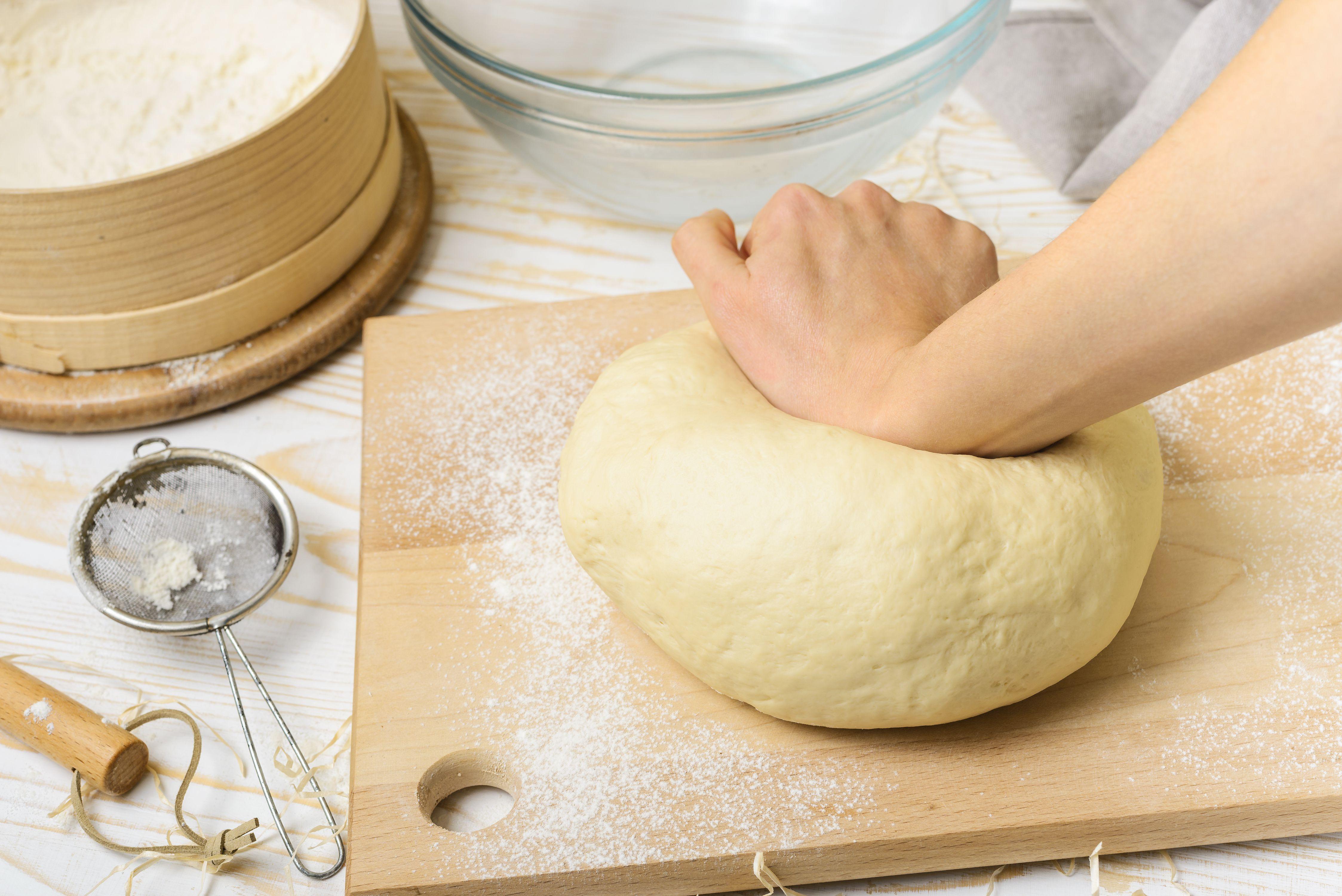 Pressing down on dough