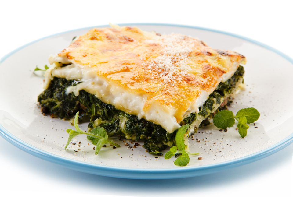 Vegetarian lasagna on white background