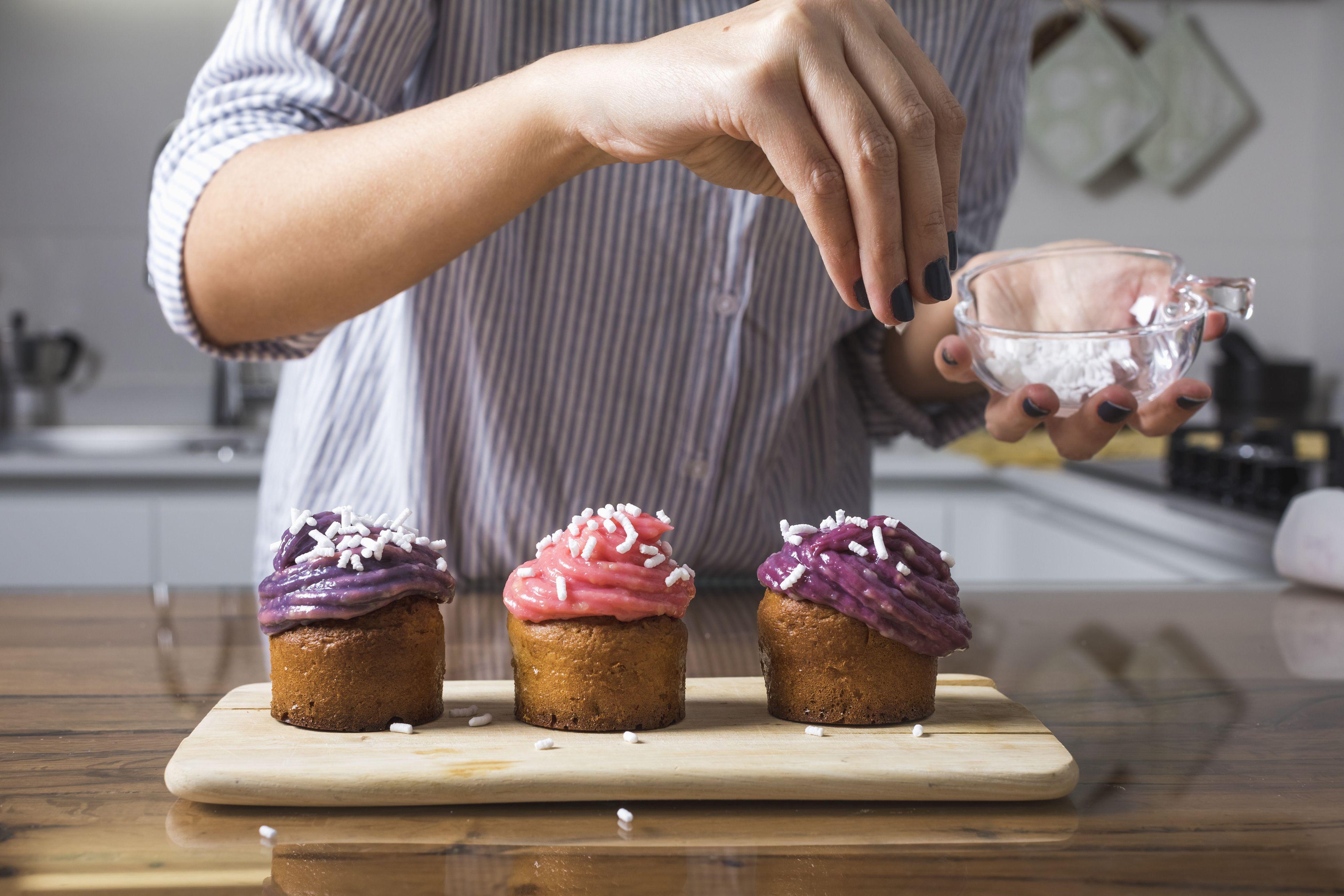 Woman preparing muffins at home
