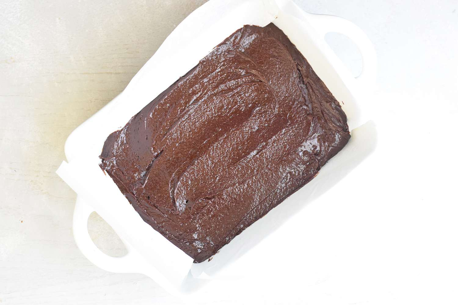 Add the brownie batter to the pan