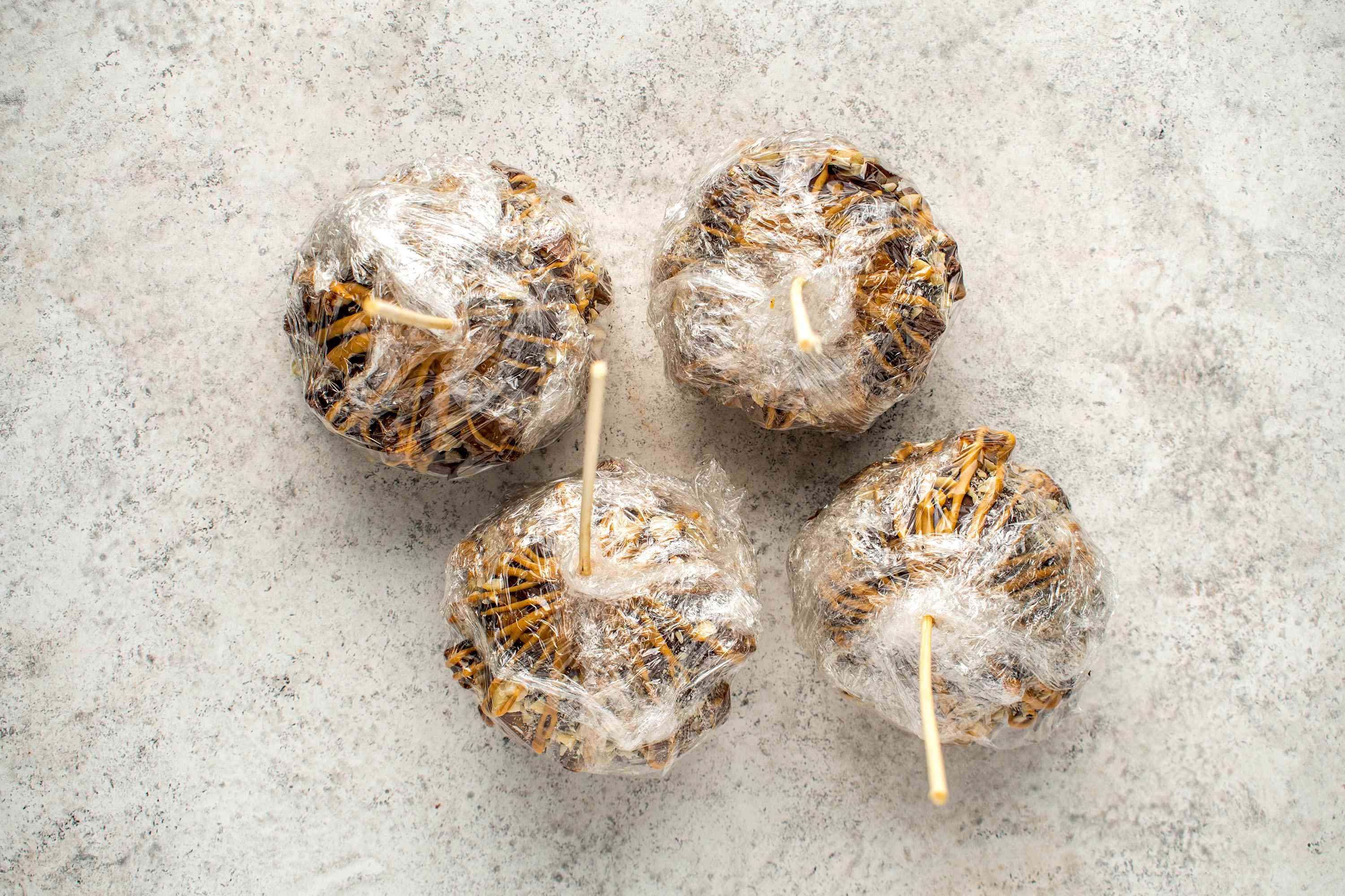 Peanut Butter Caramel Apples wrapped in plastic wrap