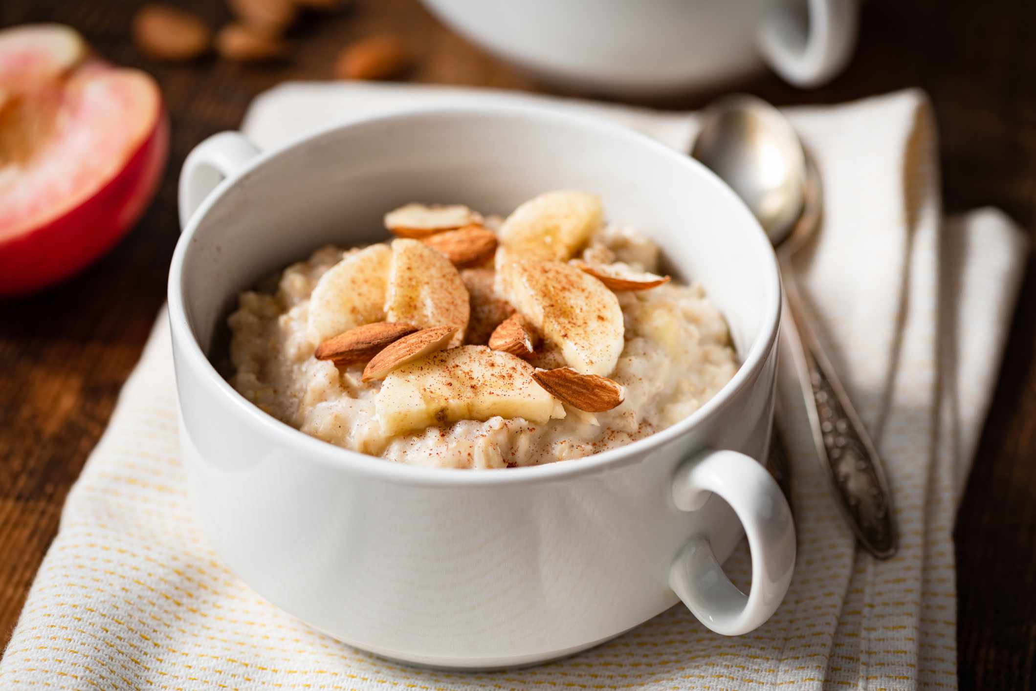 Crock pot apple cinnamon oatmeal topped with fruit and nuts