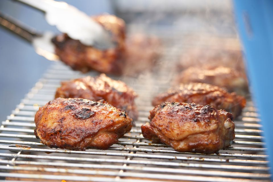 Chicken thighs cooking on the grill
