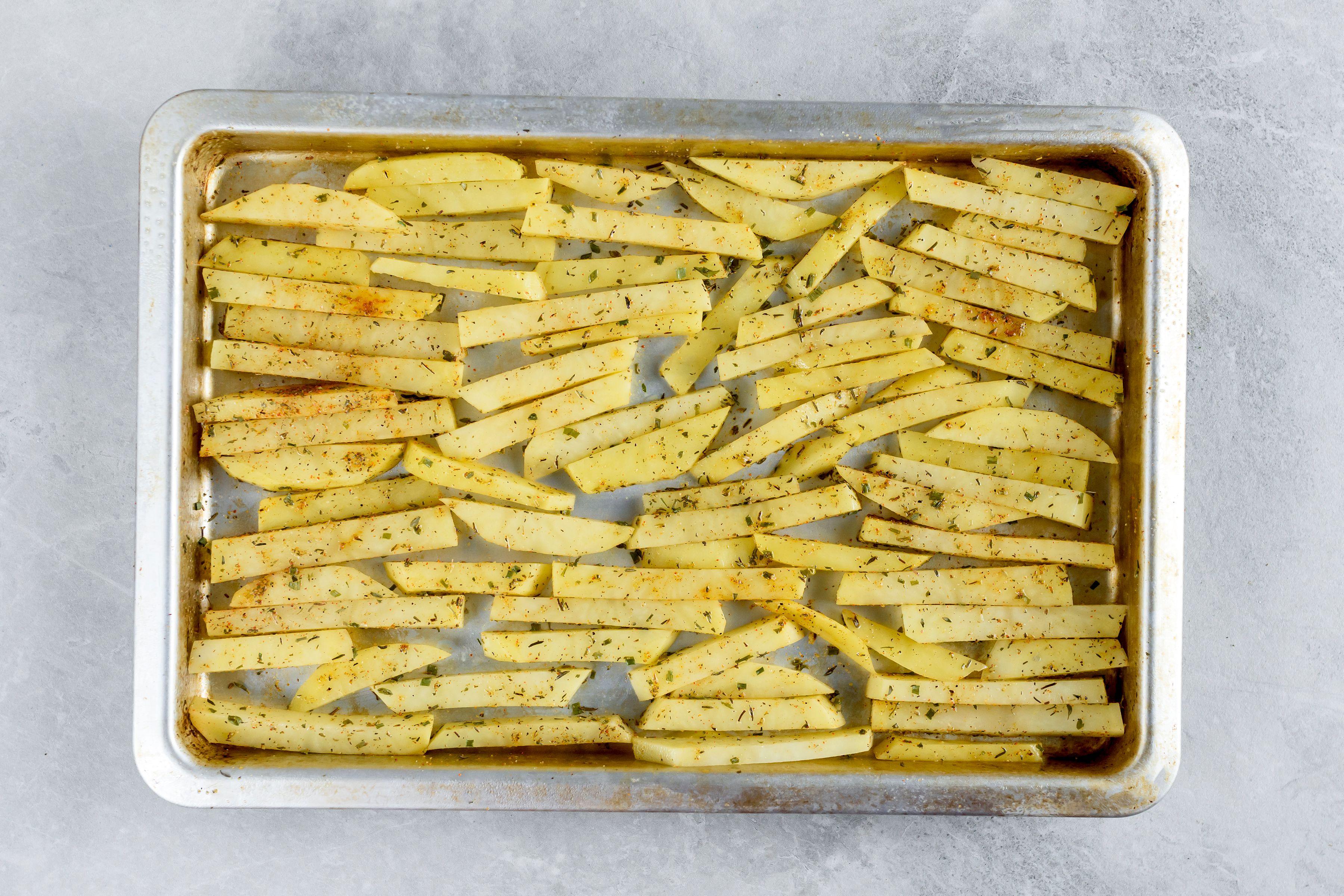 Potatoes arranged on a baking sheet