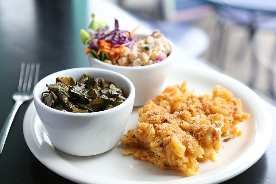 collard greens and macaroni and cheese on a plate