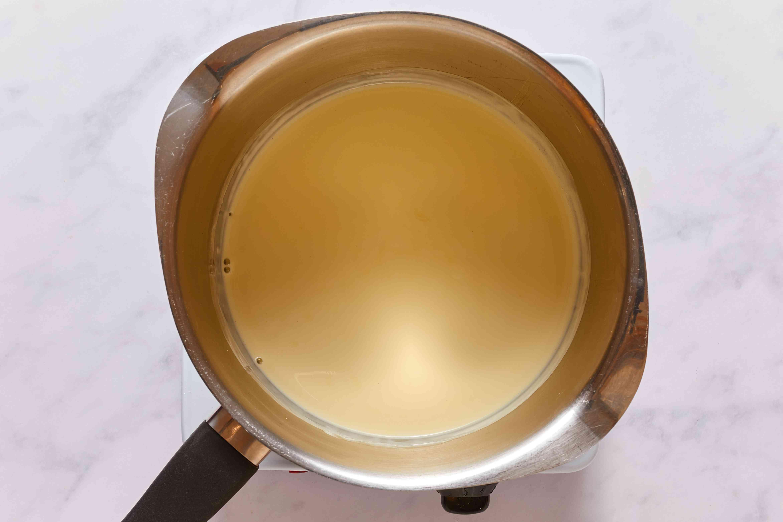 In a small saucepan, gently warm heavy cream