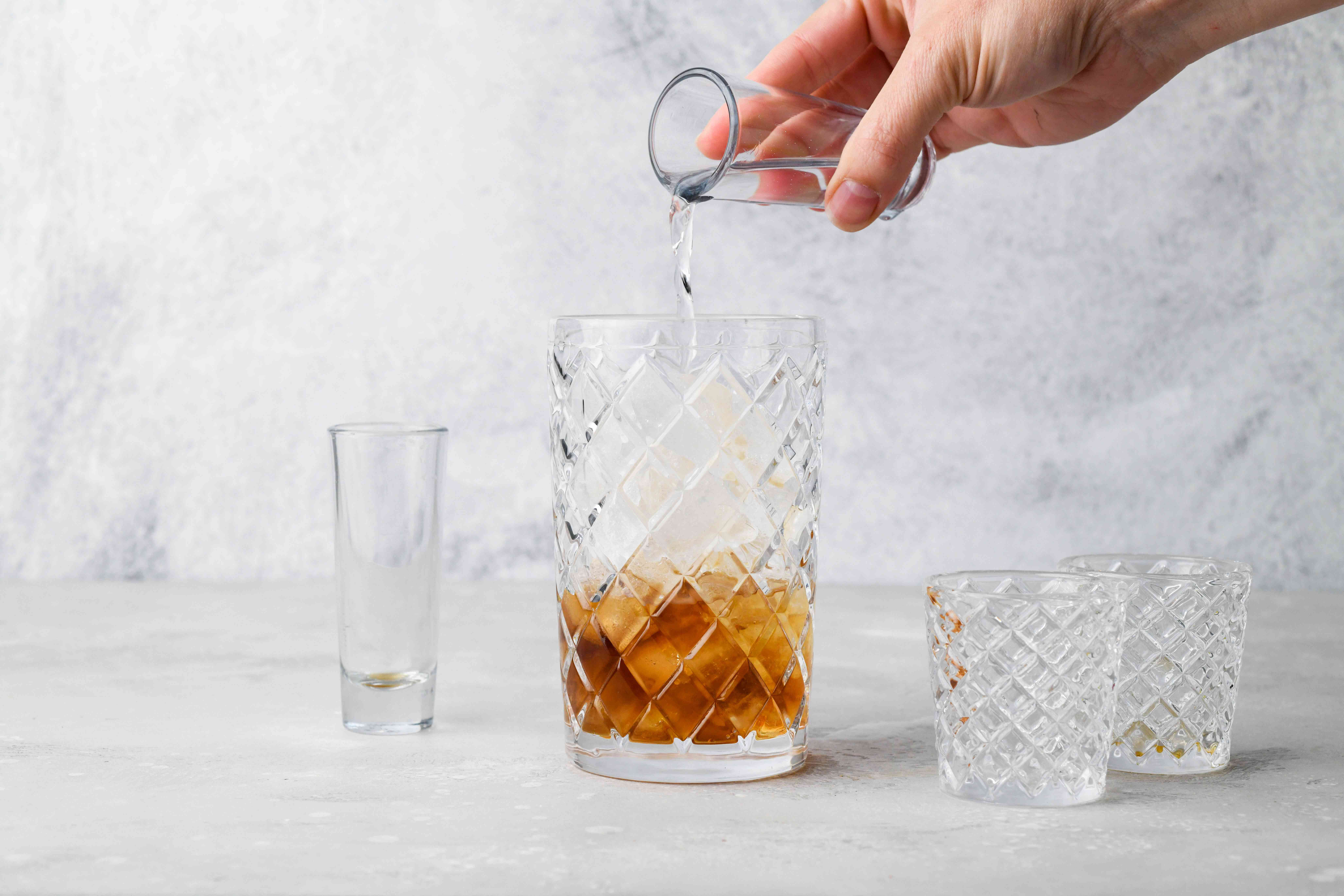 In a cocktail shaker filled with ice, pour the ingredients