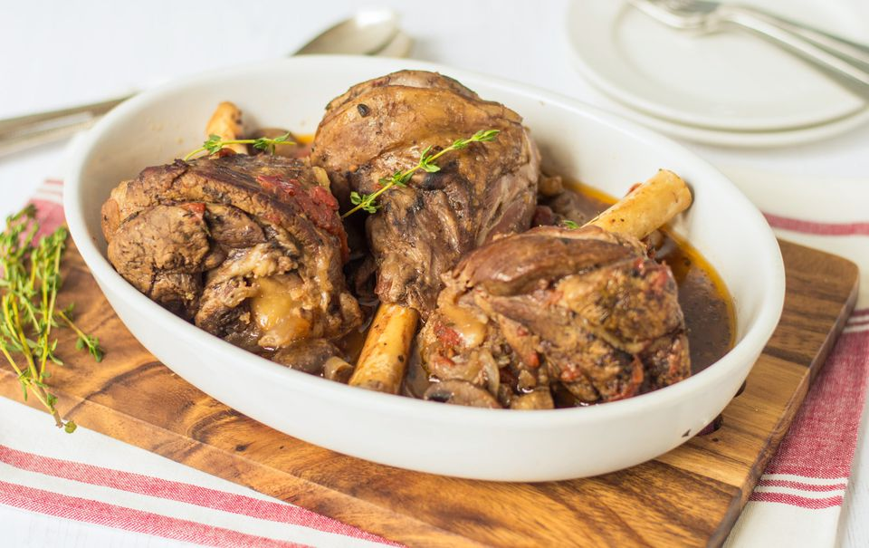 Crock pot lamb shanks in a serving dish