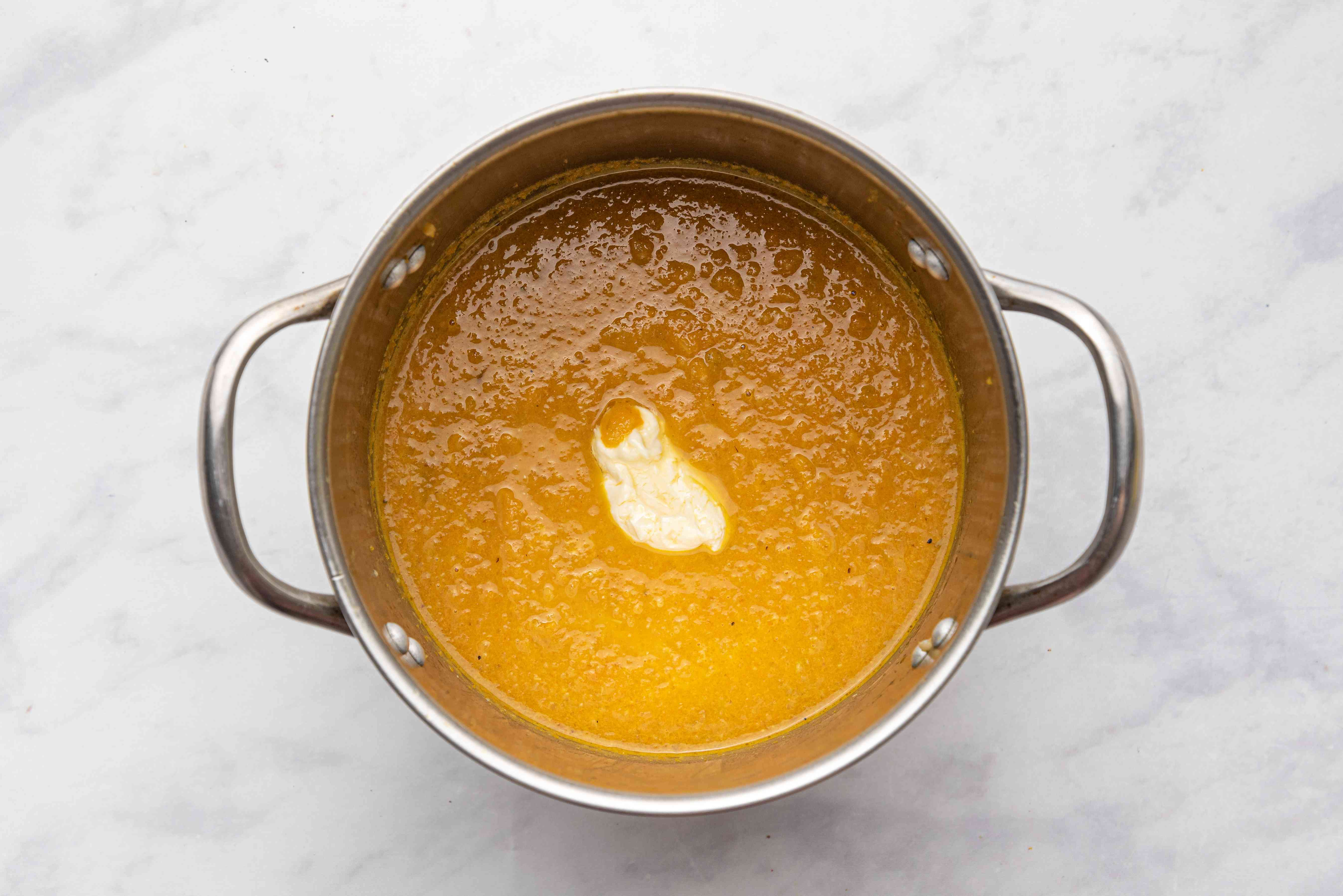 Roasted Carrot, Apple, and Celery Soup (Pareve or Dairy) with butter in a pot