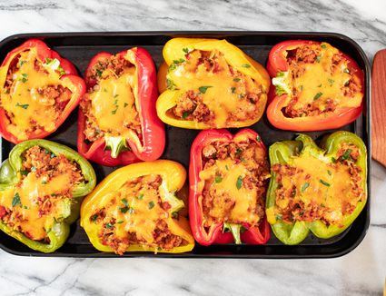 stuffed peppers in a serving tray