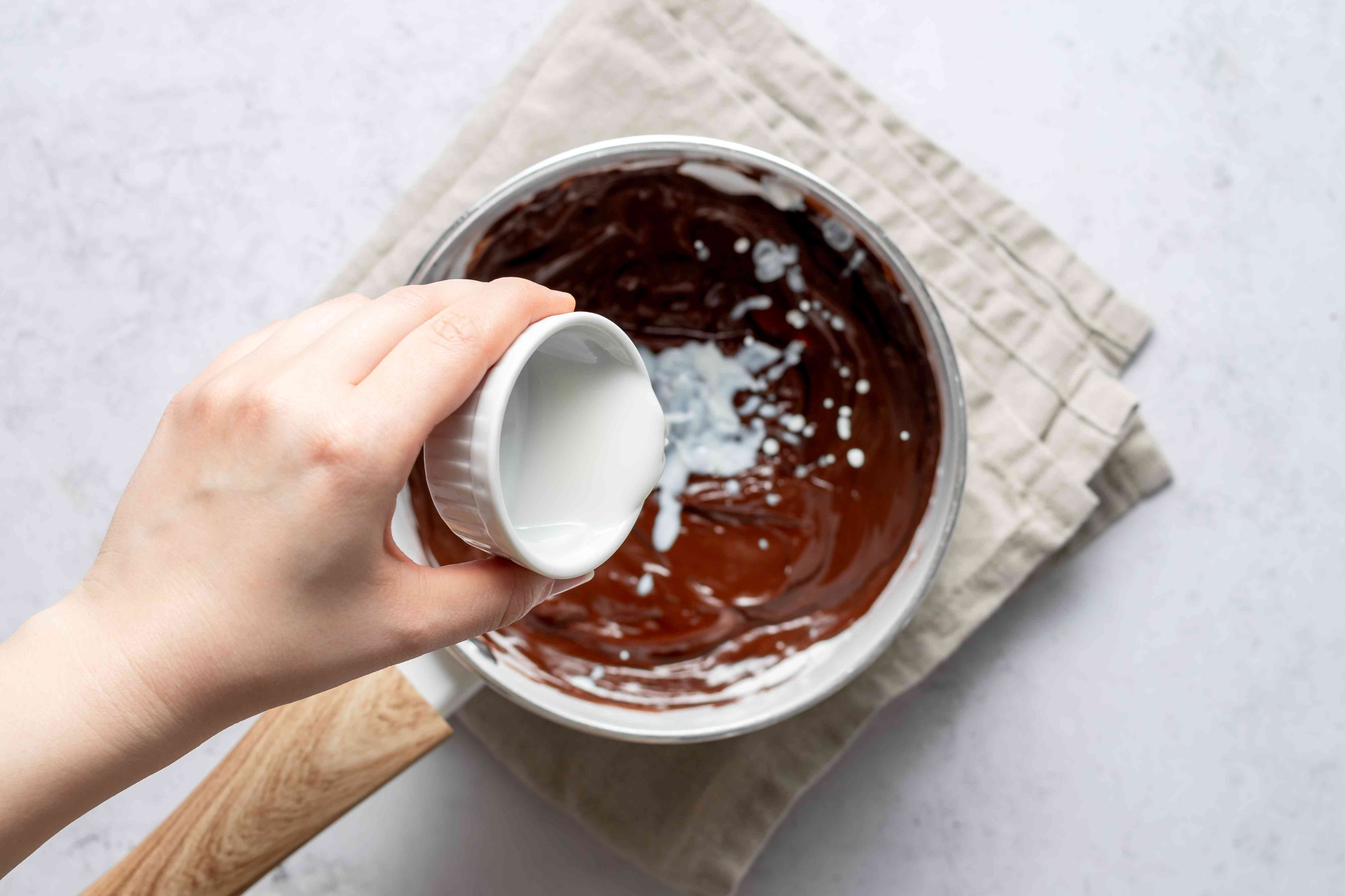 Add milk and agave syrup to the chocolate mixture
