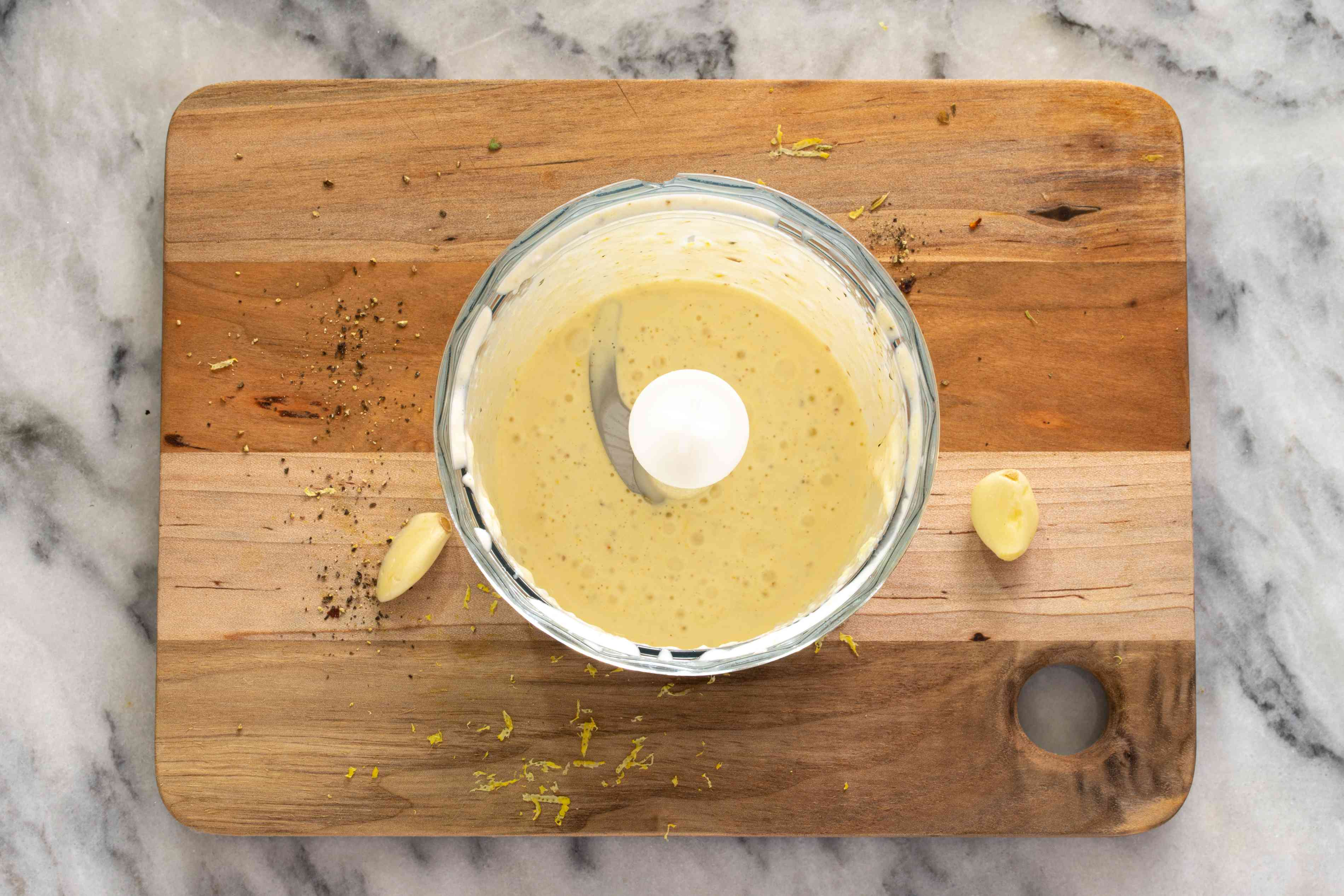 aioli in an immersion blender container with garlic