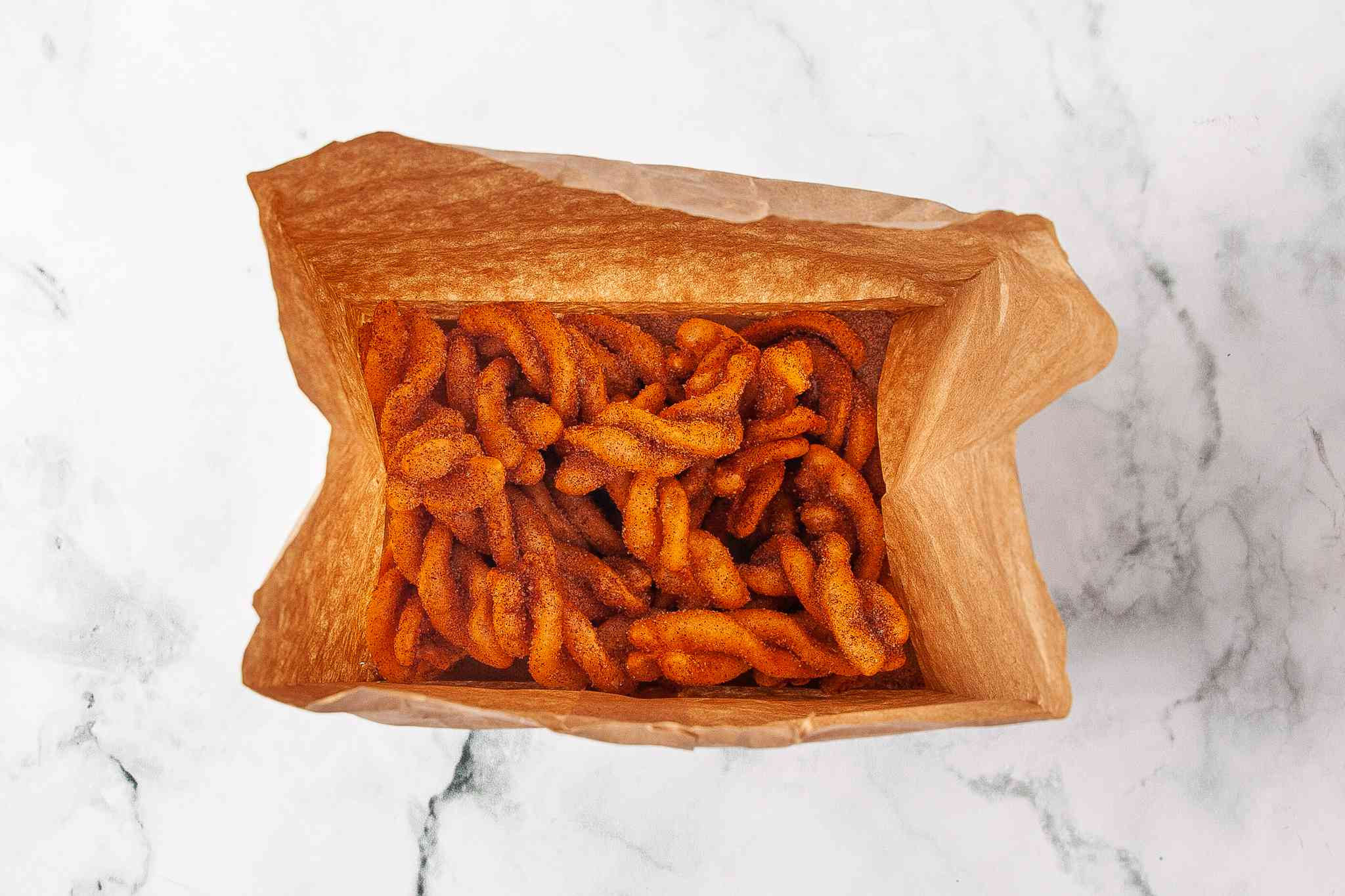 Duros in a paper bag with the cinnamon and sugar