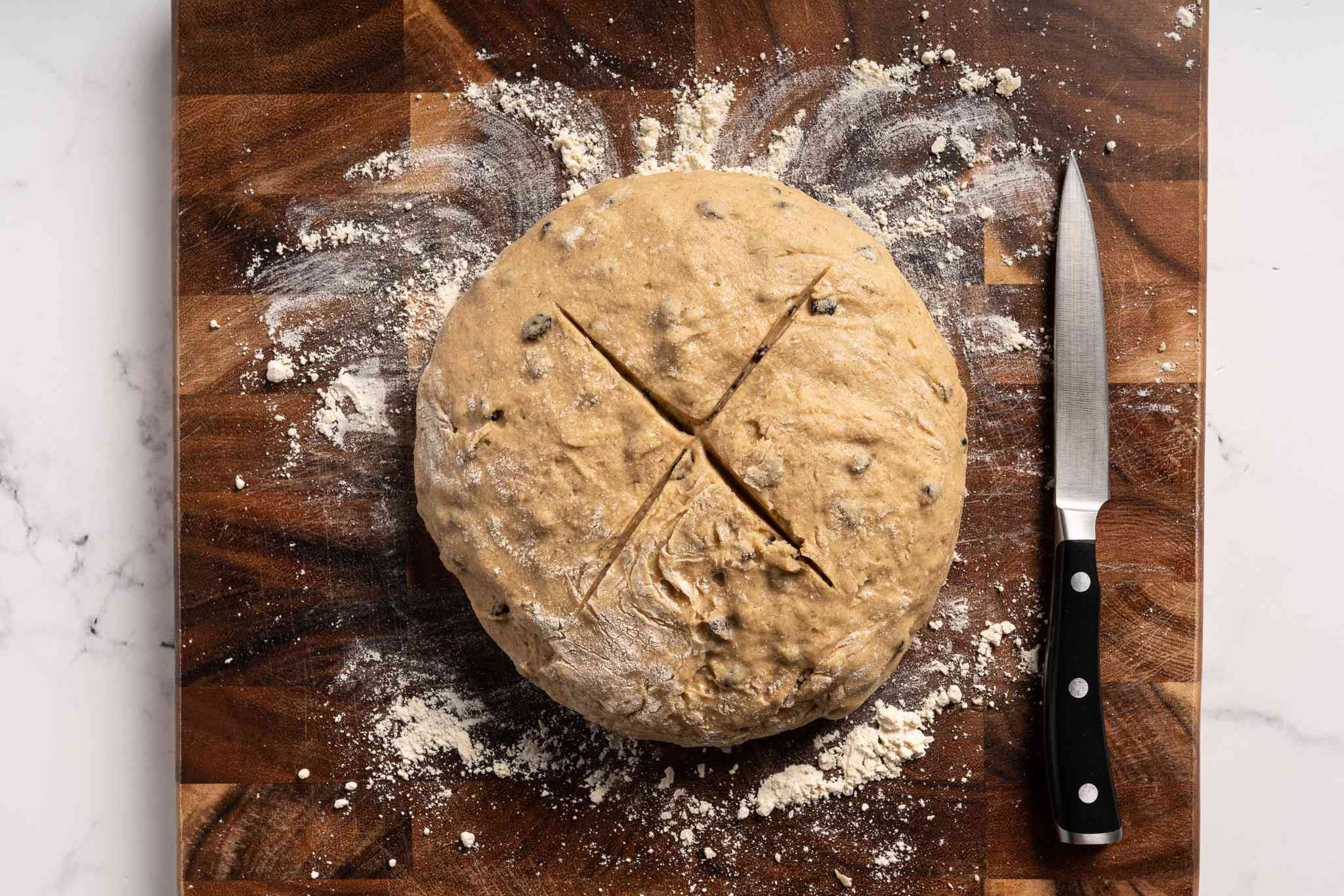 cut a cross on top of the dough
