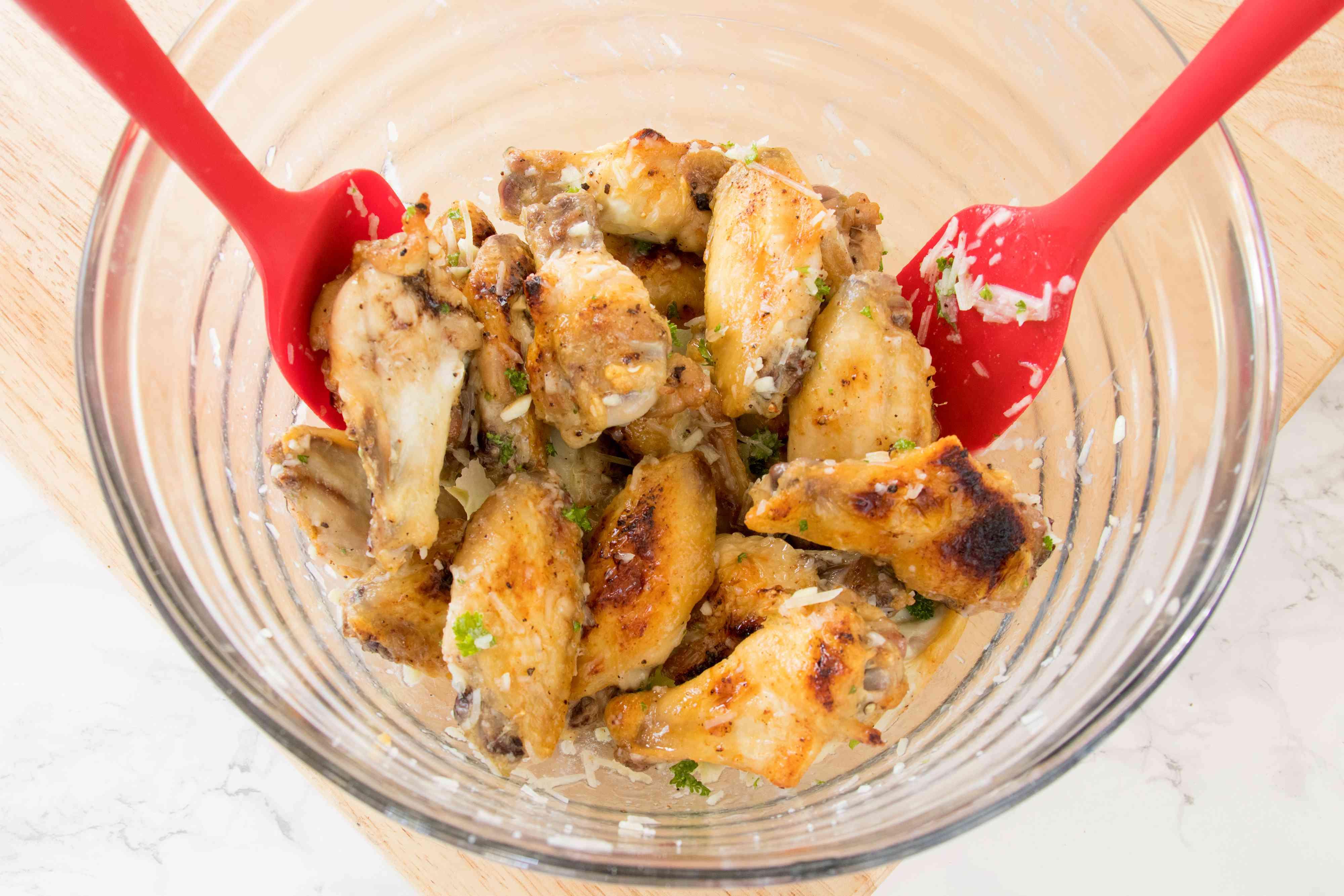 Tossing garlic-Parmesan chicken wings