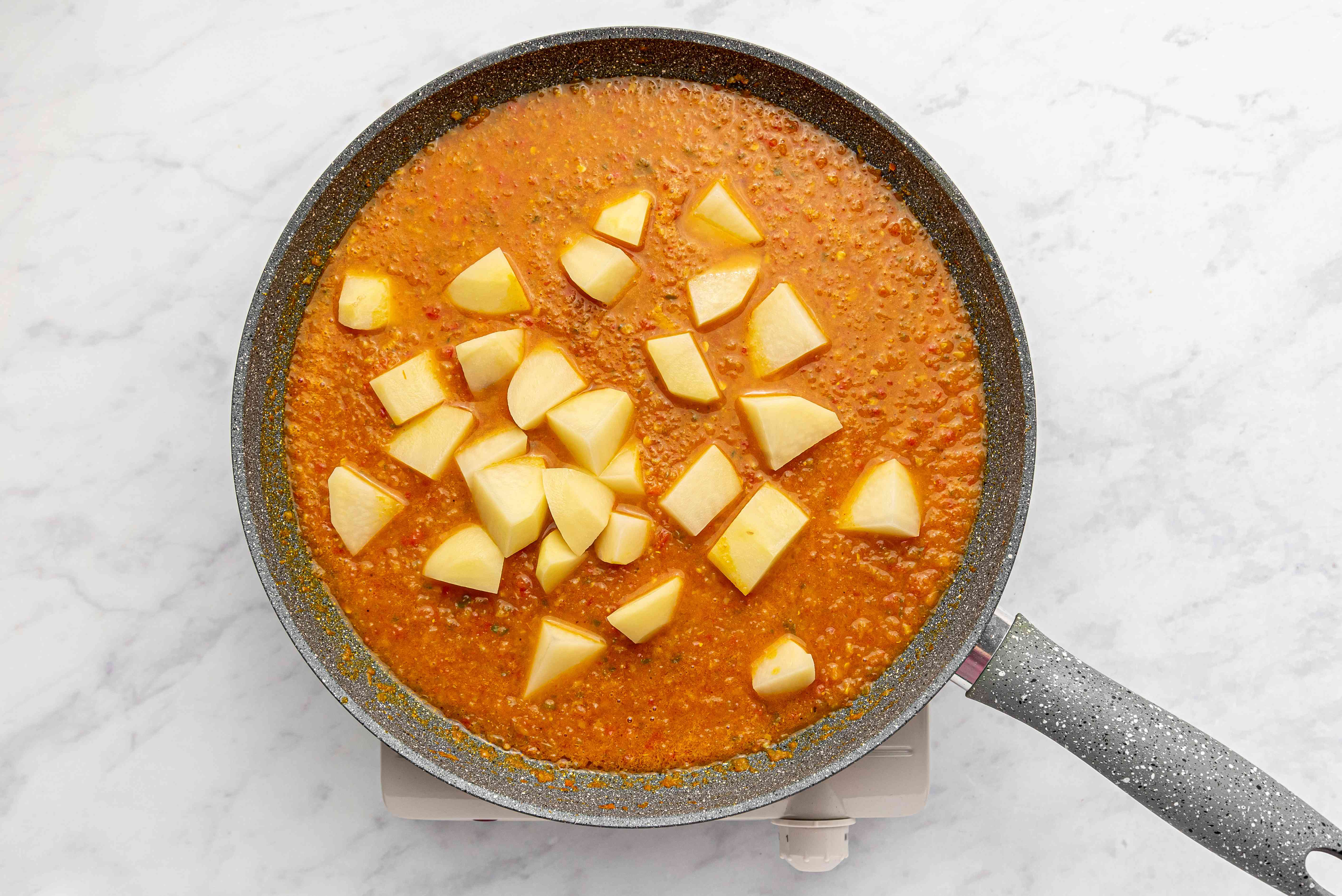 add potatoes to the masala in the pan