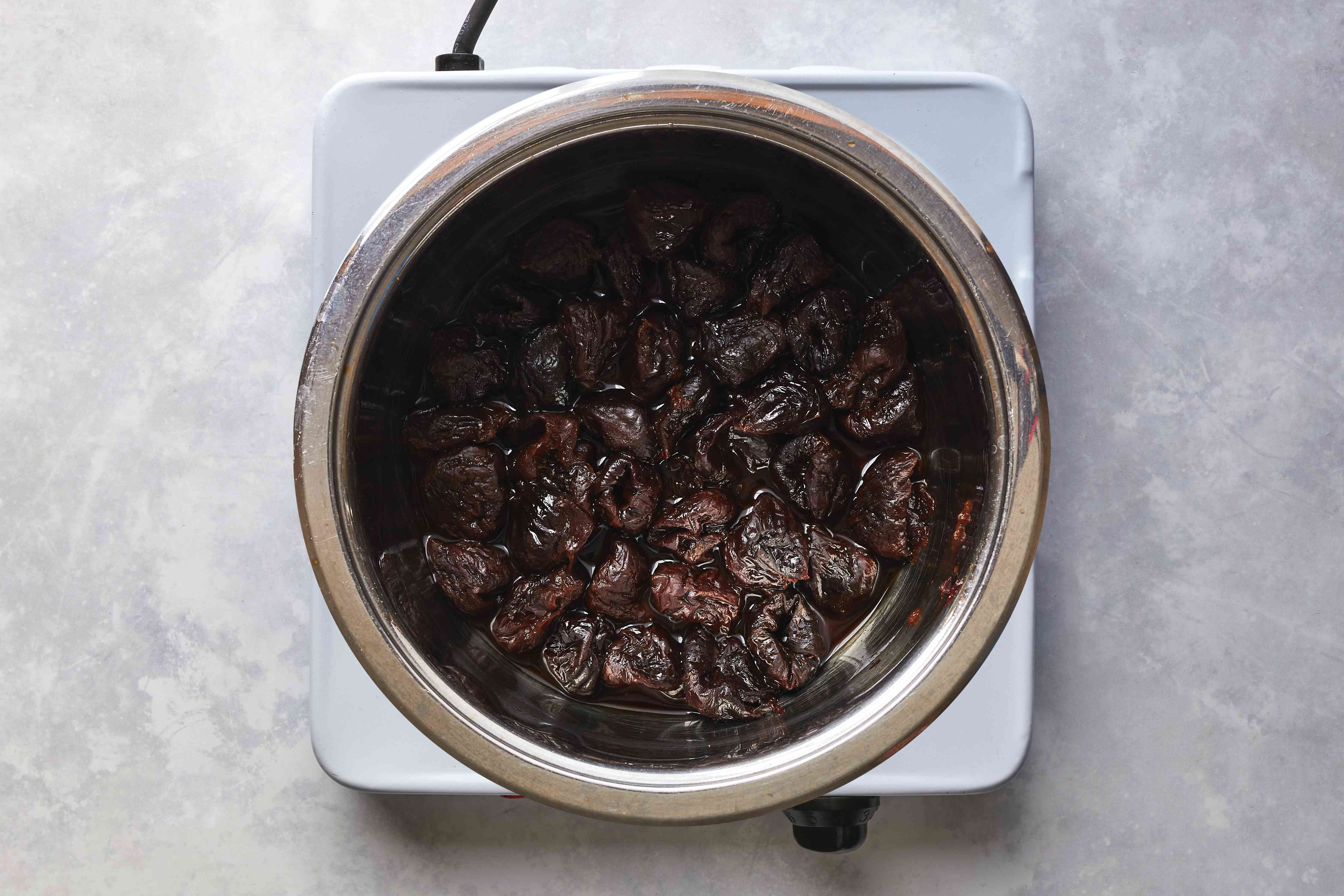 prunes with water in a pot