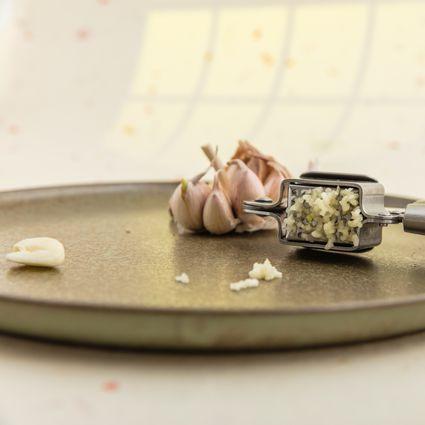 Minced garlic with garlic press.