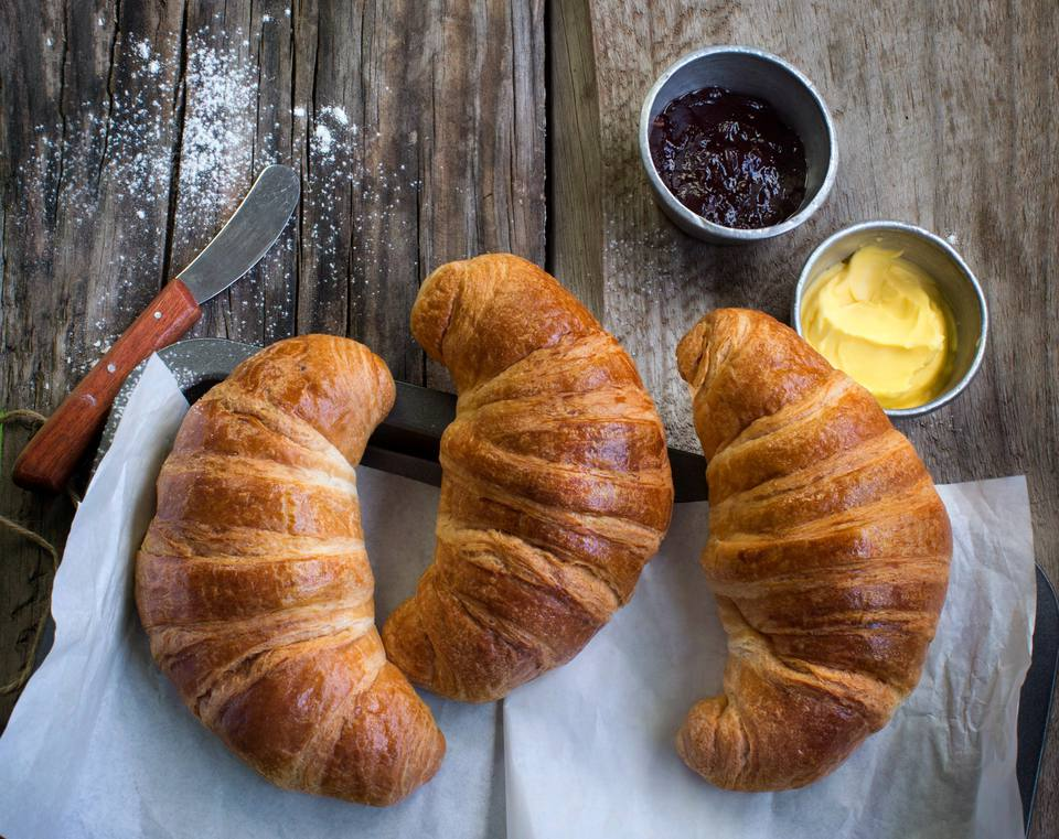 Croissants with butter and jam