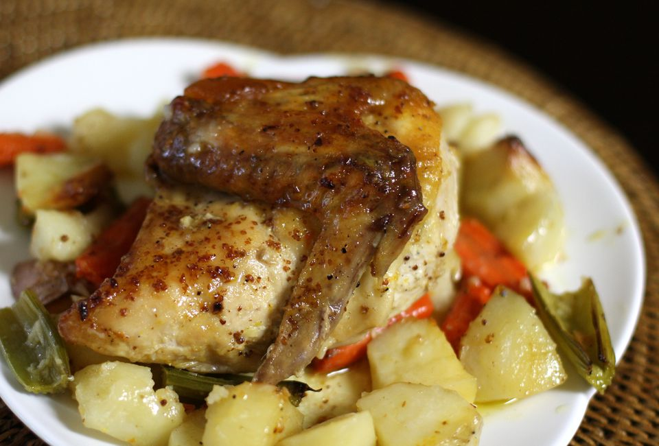 Roasted chicken with potatoes and carrots