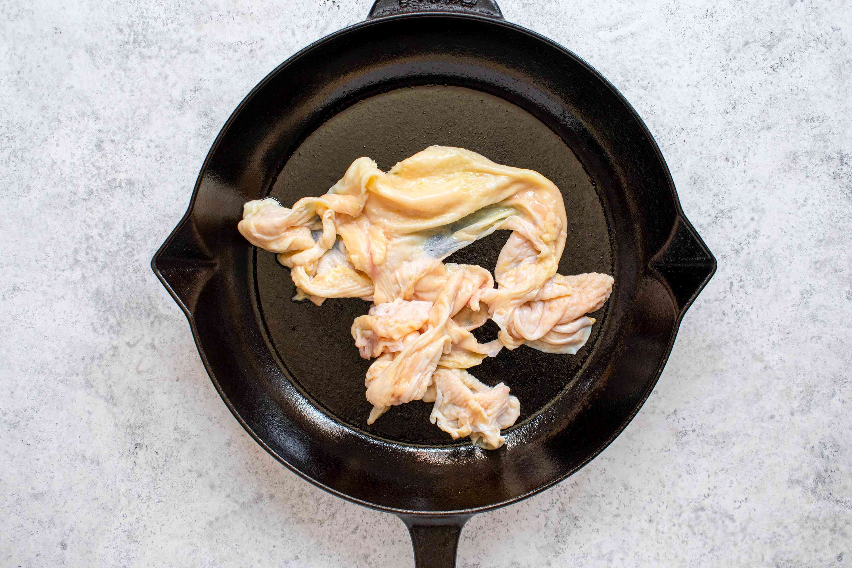 chicken skin in a skillet