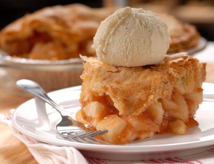 Piece of apple pie with vanilla ice cream
