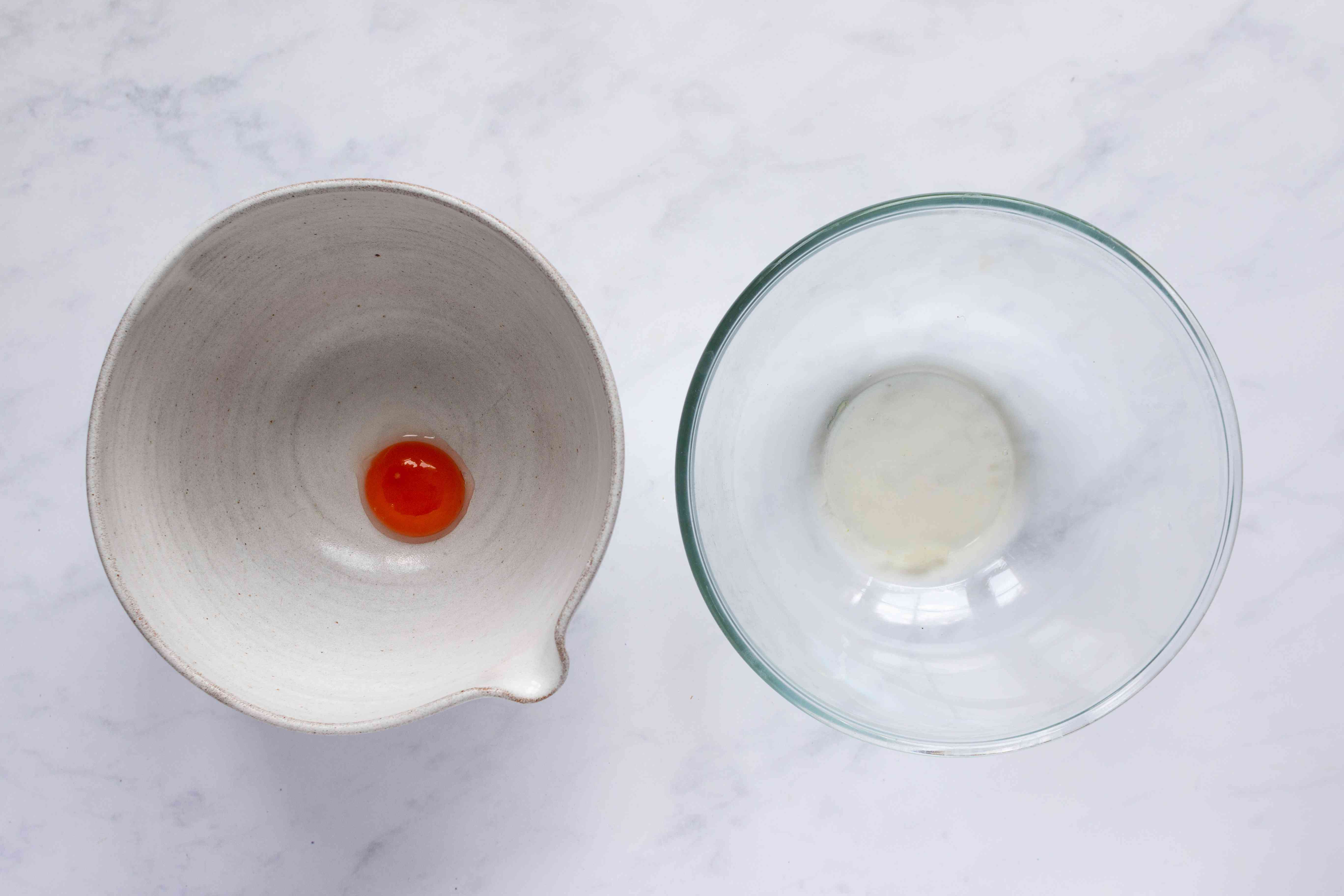 egg white and egg yolk separated into bowls
