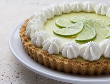 Key Lime Pie With Graham Cracker Crust and Whipped Cream on a Marble Tabletop.