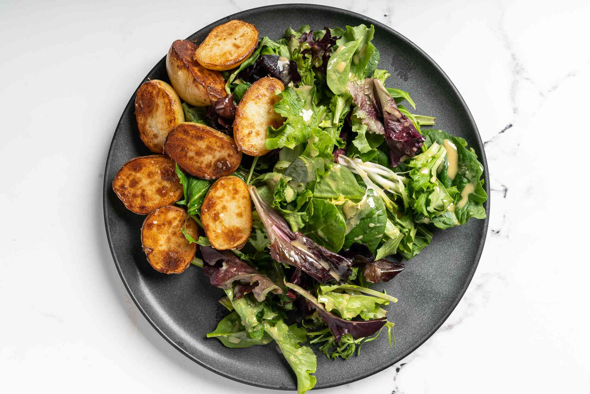 potatoes and lettuce on a plate