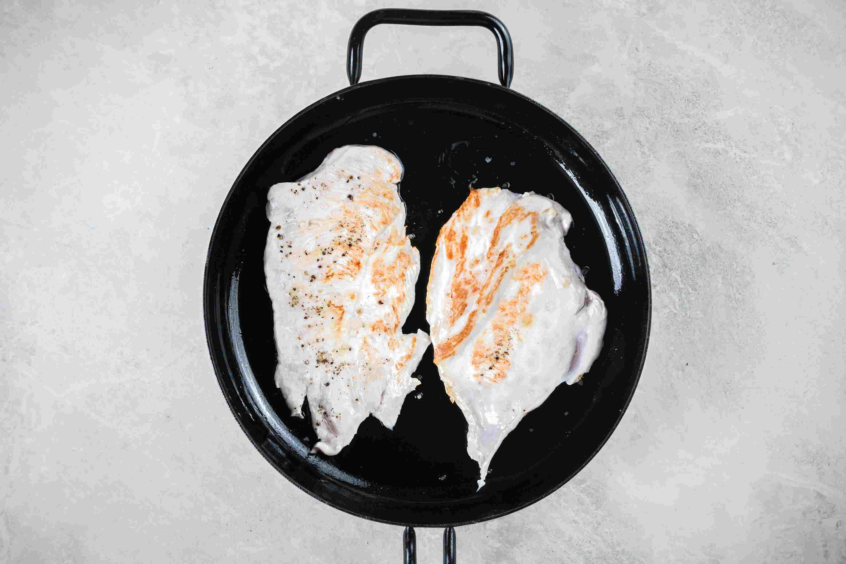 Browned turkey breasts in cast-iron skillet