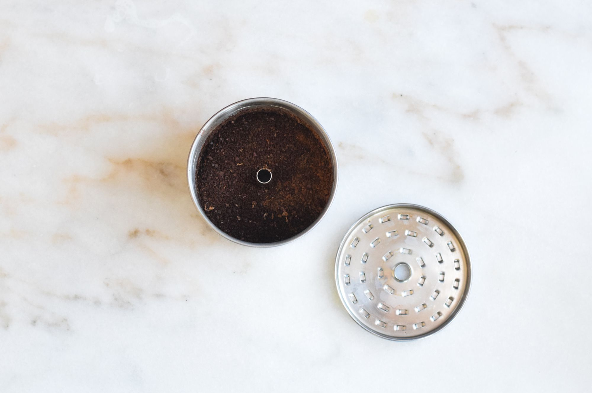 coffee grounds and cinnamon in coffee pot