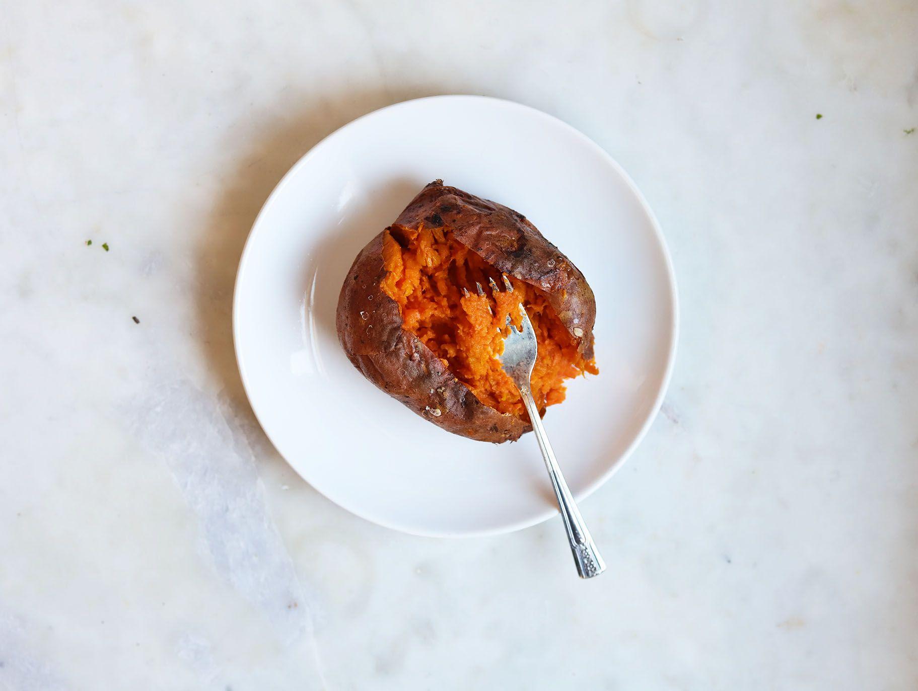 sweet potato cut open and mashed