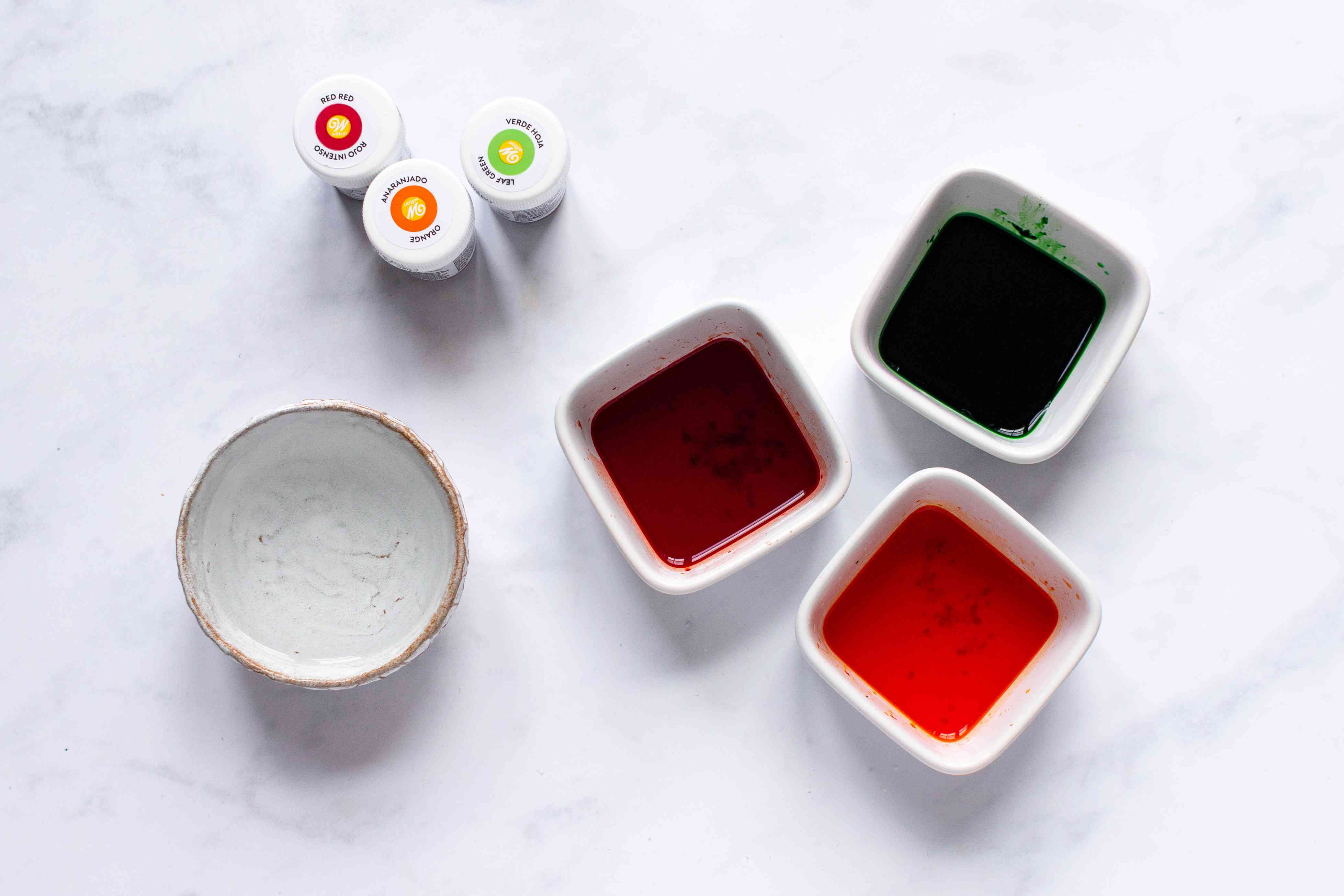 water and food coloring in bowls