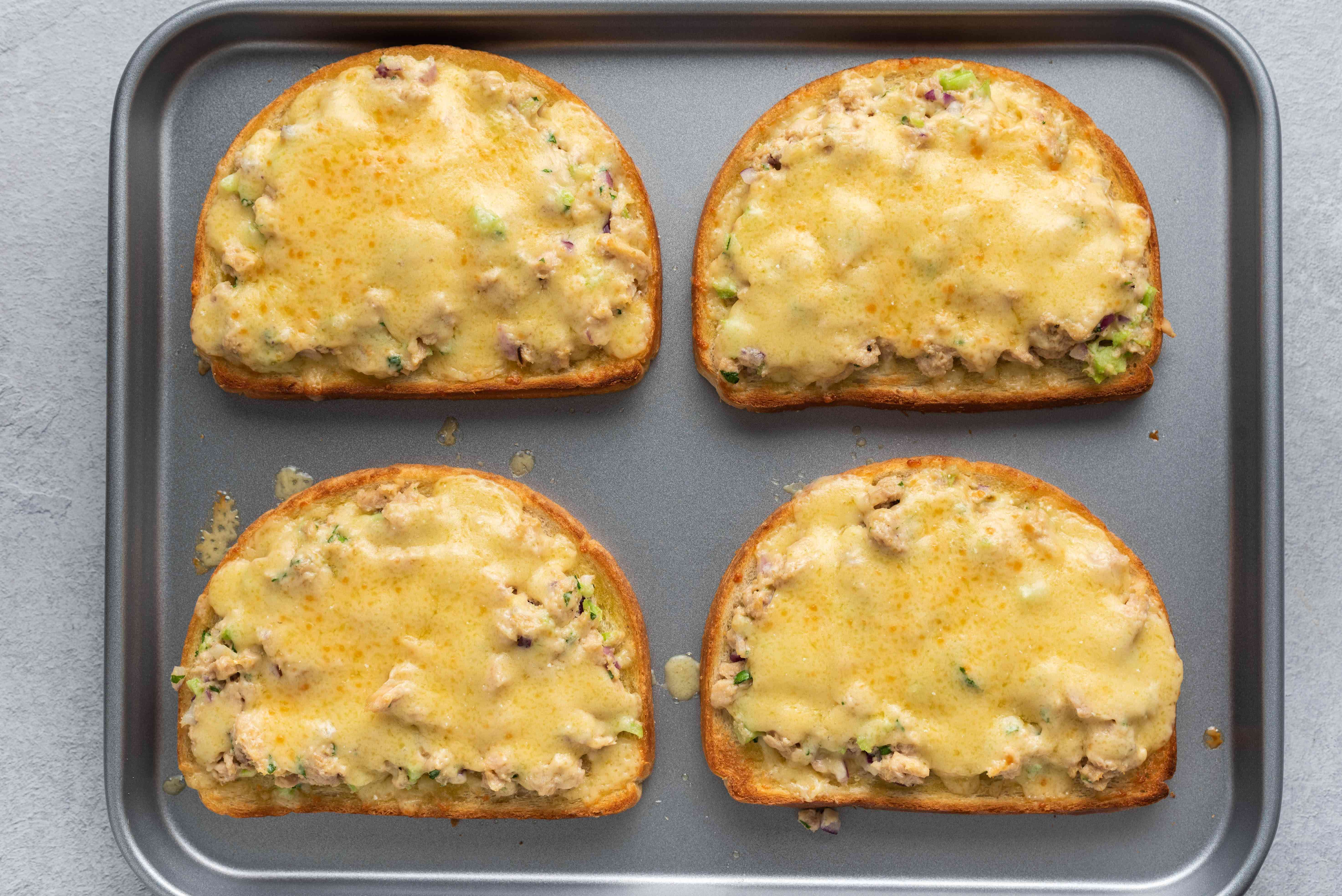 bread slices with tuna salad and melted cheese on top