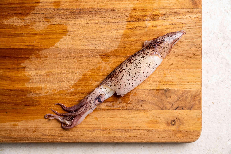 whole squid on a cutting board